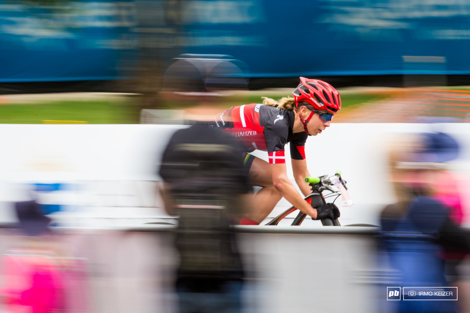 Annika Langvad going into her final lap taking no chances and aero-tucking it all the way down the finish straight.