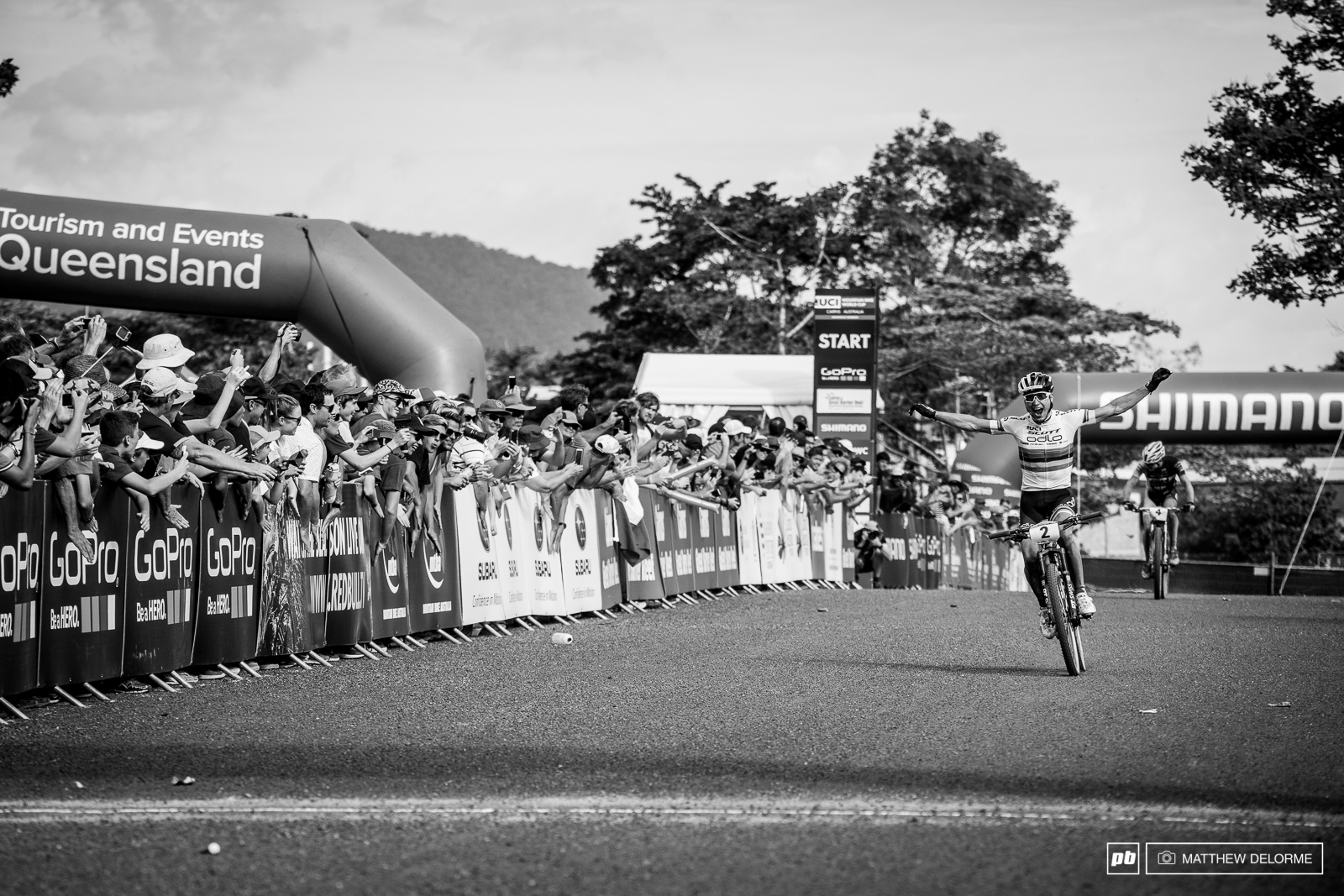 Nino Schurter crosses the line with Maxime Marotte coming in just behind him.