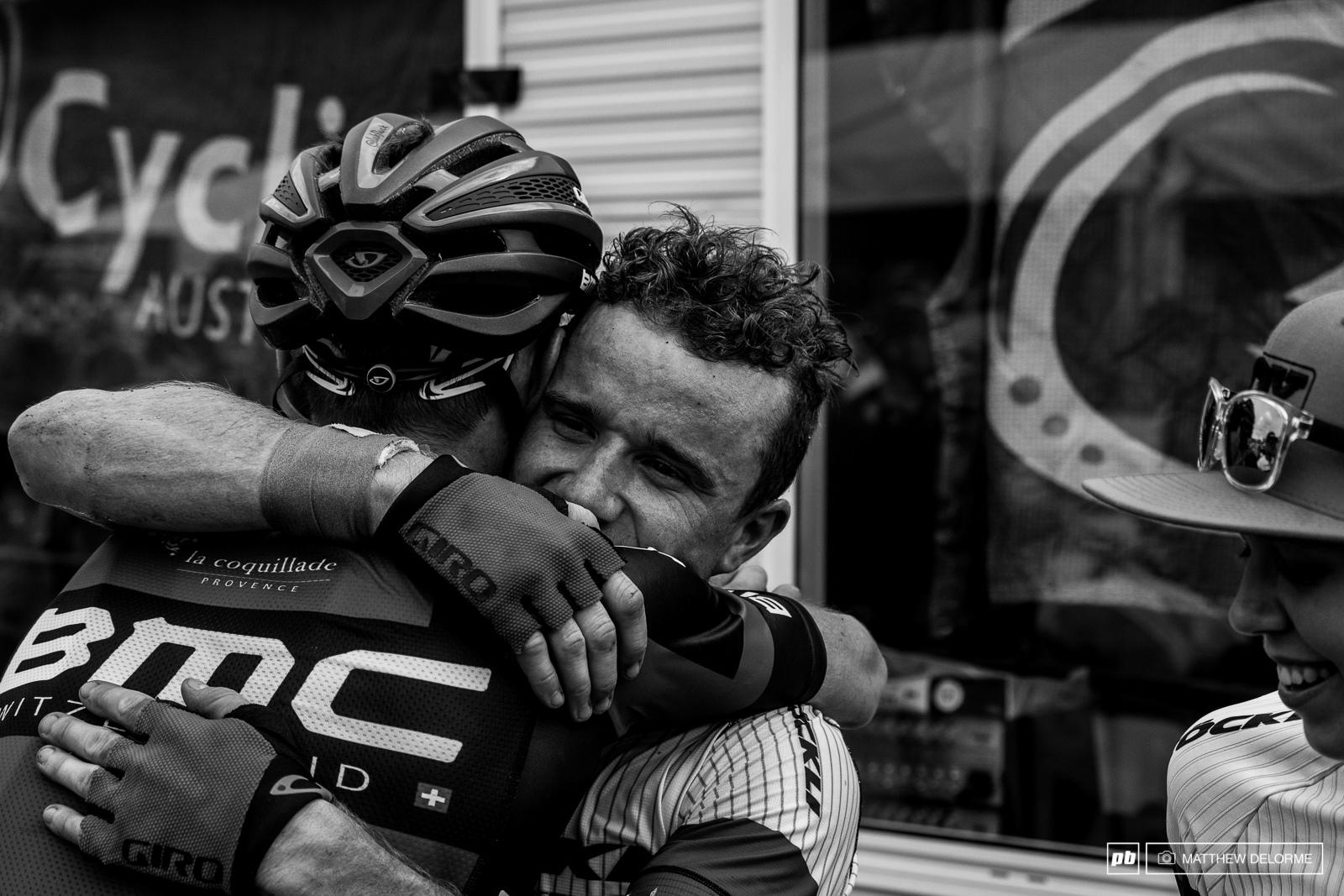Lukas Fluckiger congratulates brother Mathias on a race well ridden.