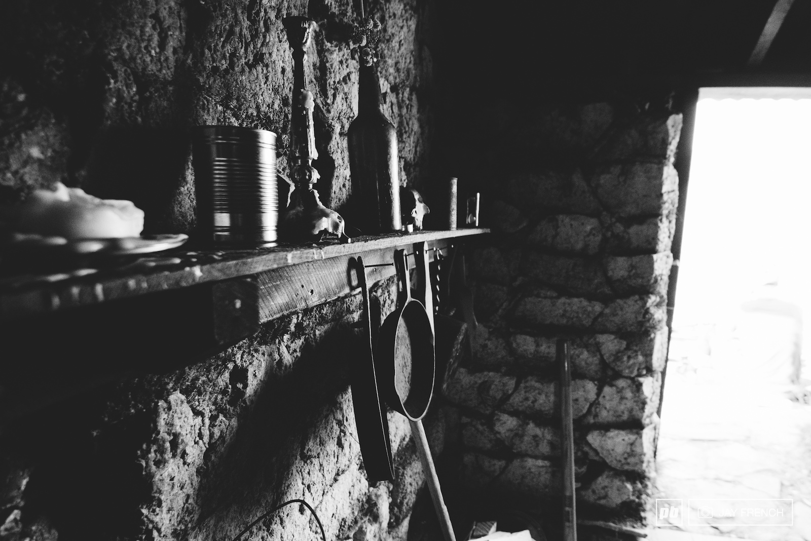 Inside the mud hut proper old tools of the trade.