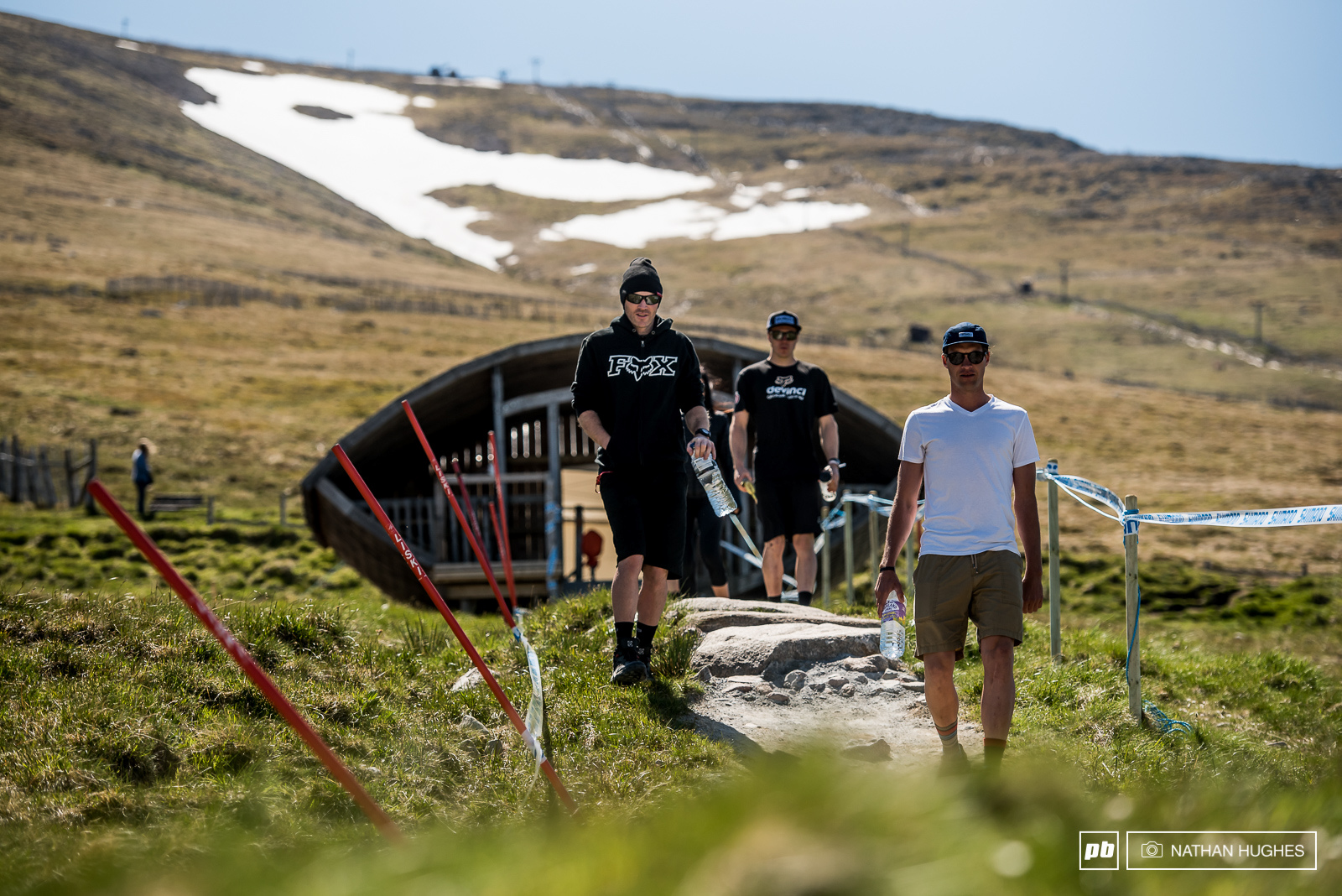 Greg Minnaar and Mark Wallace out of the gate infront of smaller patch of snow than we re used to seeing in recent years.