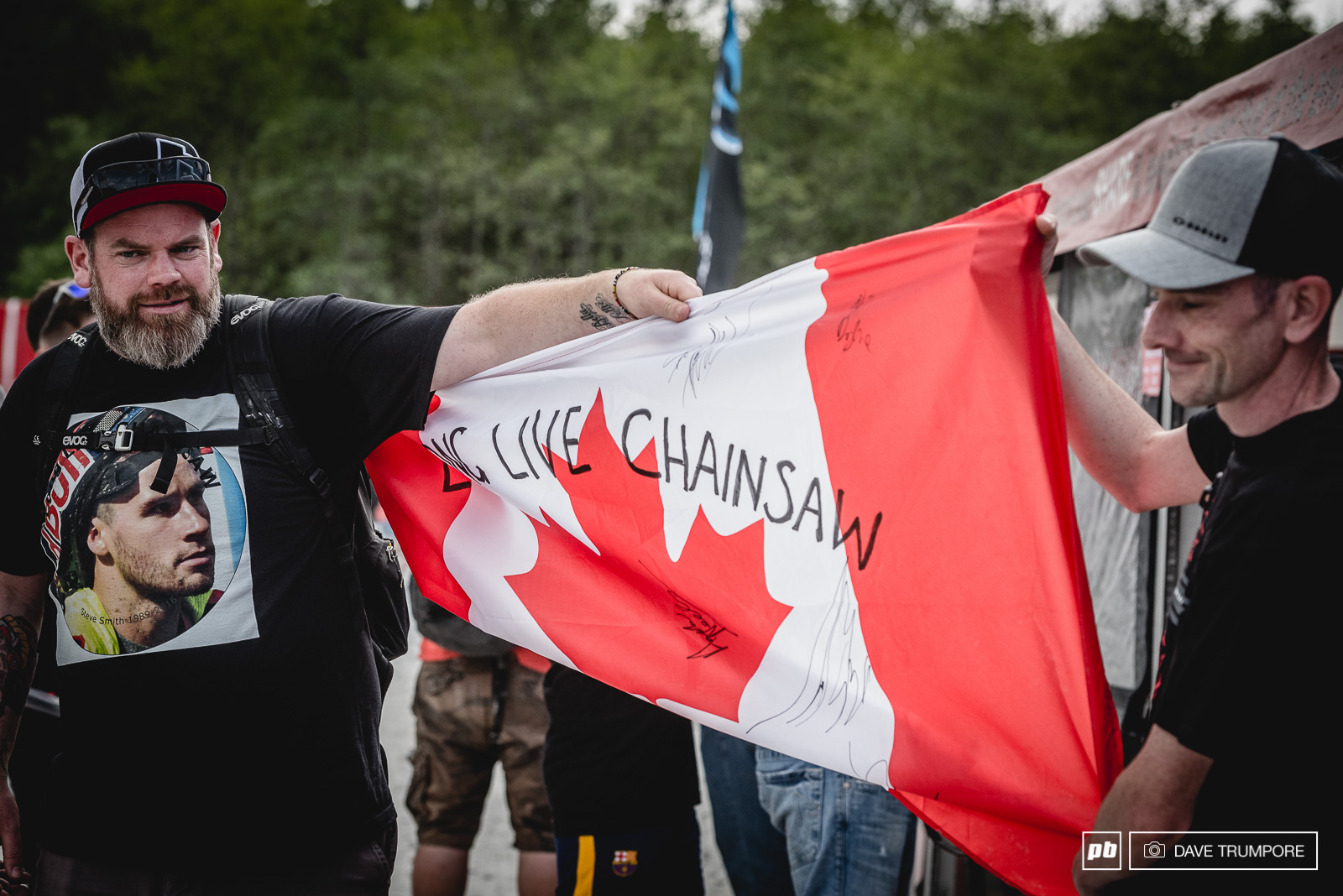 These guys walked the pits after qualifiers adding every autograph they could to this very special Canadian flag.