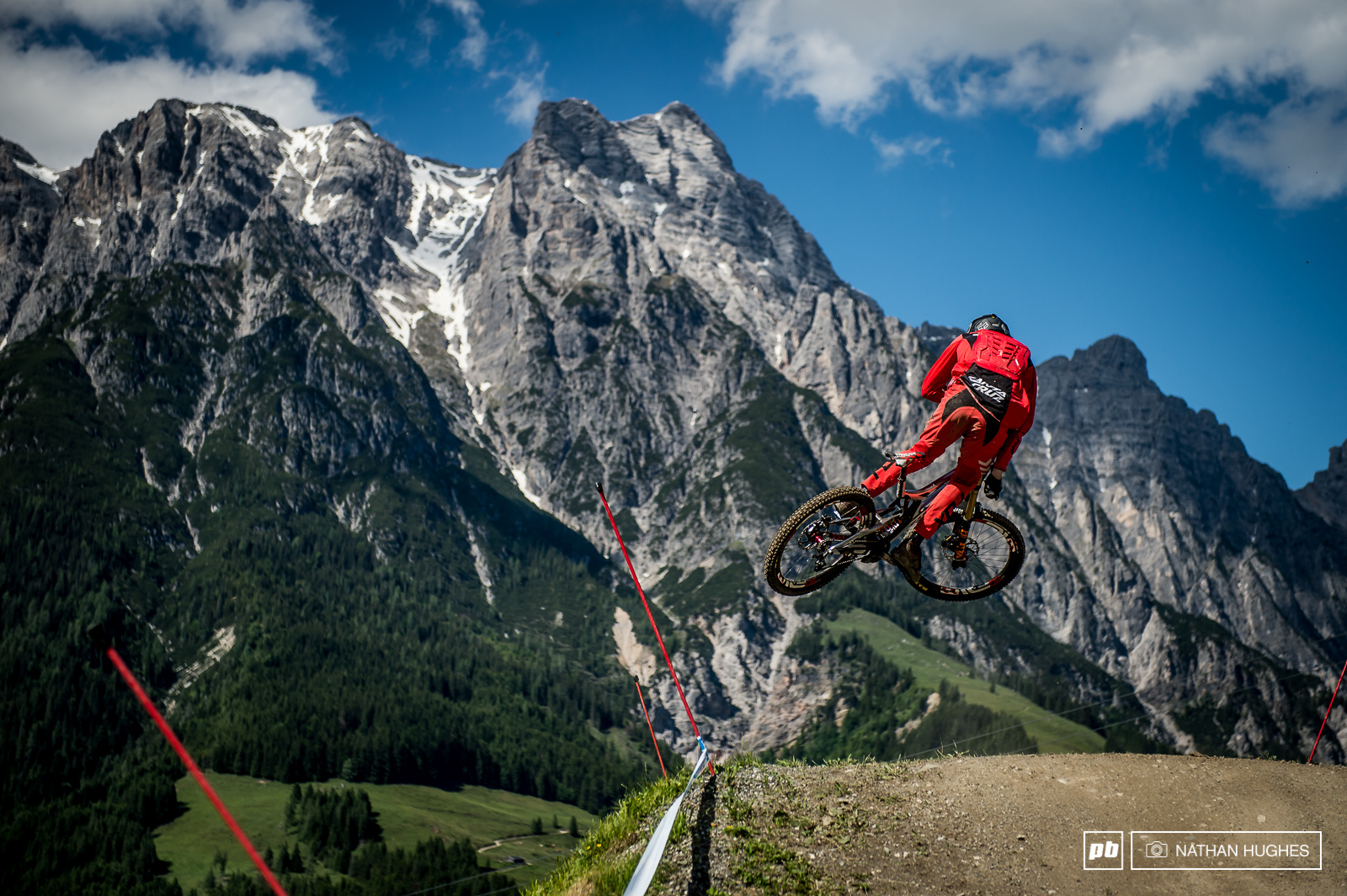 Josh Bryceland speed of a mongoose style of a rat in front of Leogang s mighty peaks.