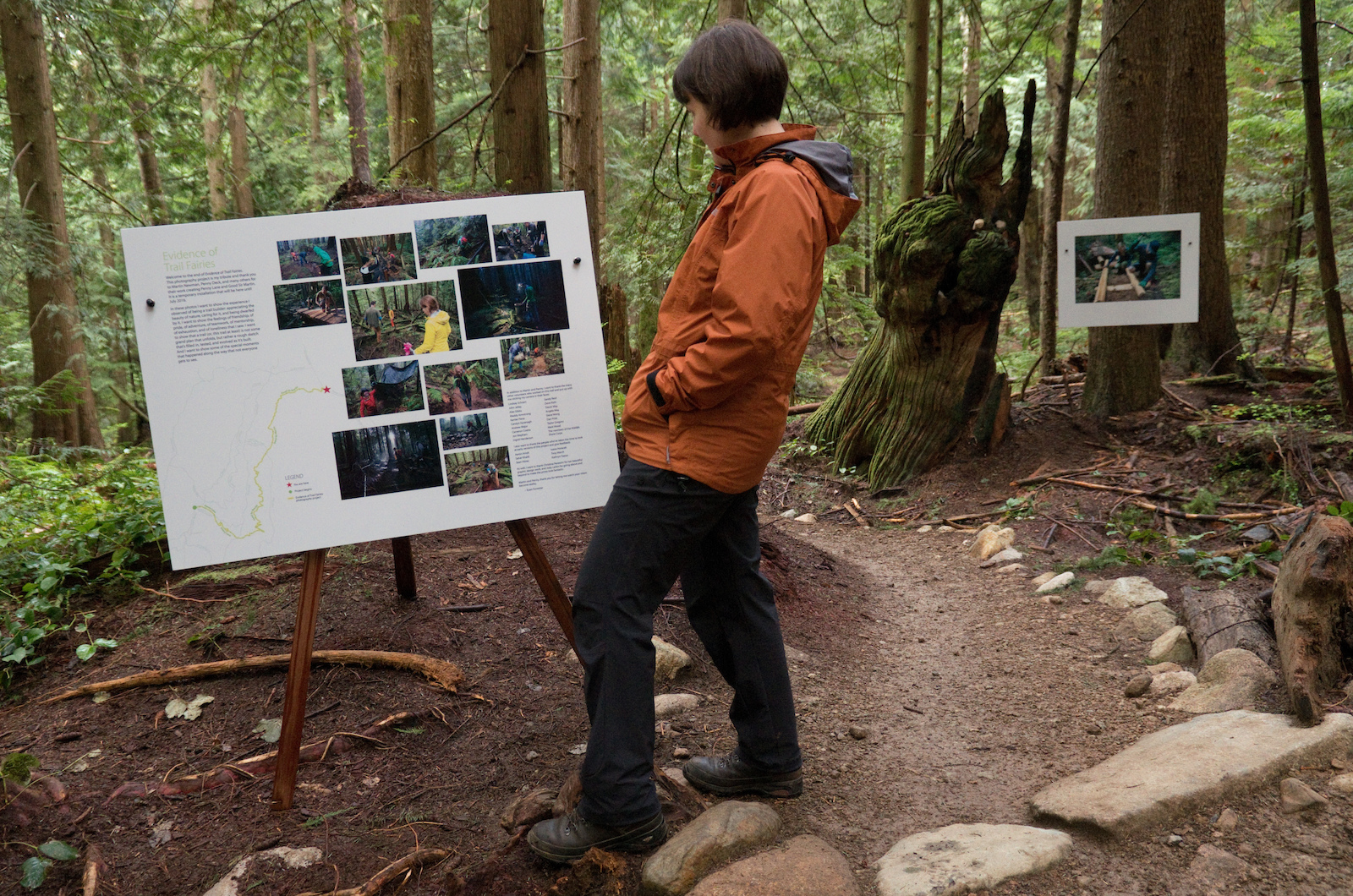 A hiker stops to read one of the informational posters we put along the installation. This is most common location for hikers and runners to first encounter the project and it s unfortunately at the end. So we included maps to help guide people to the beginning of the project so they can experience the entire thing.