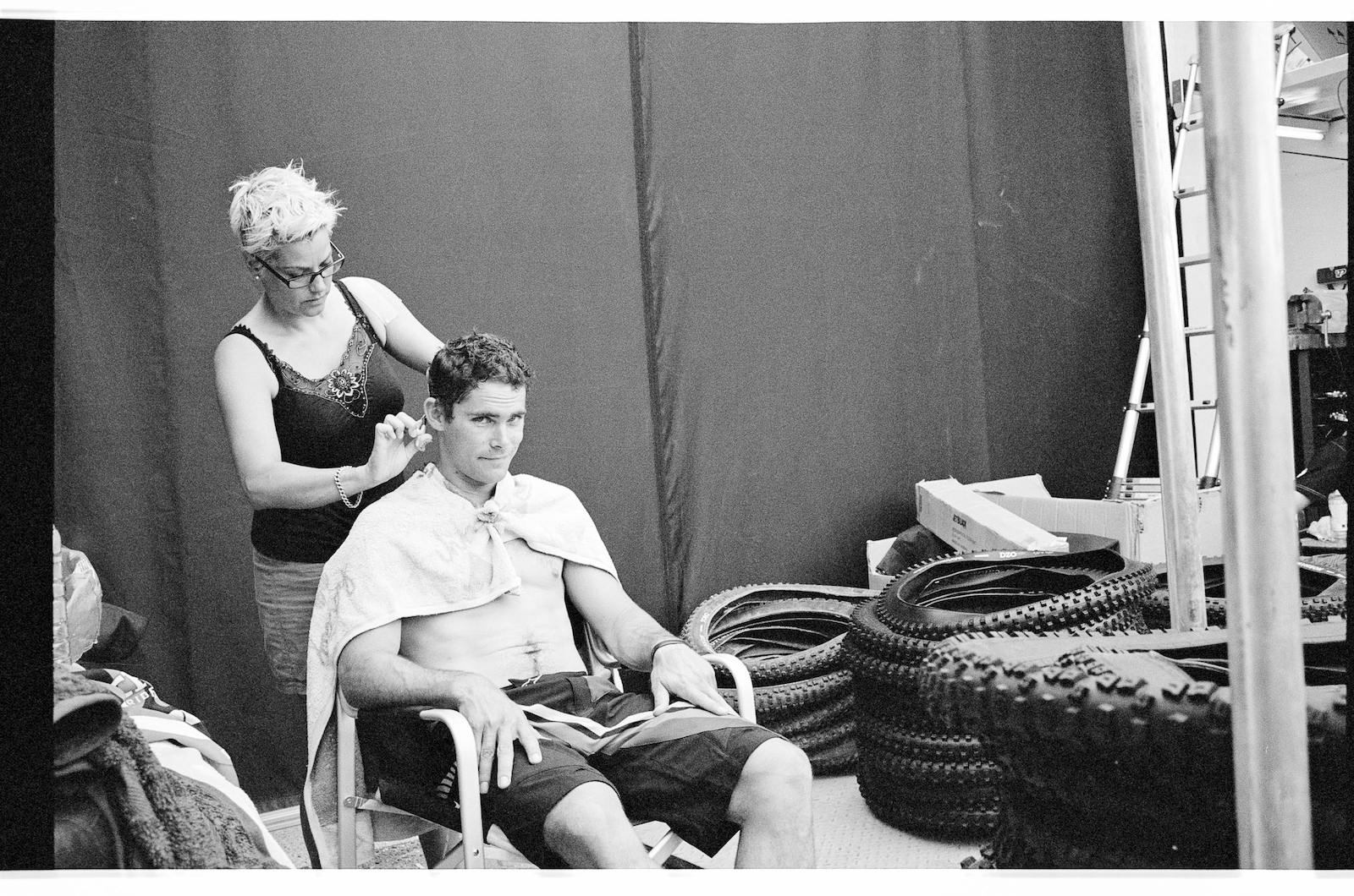 Mick Hannah getting his hair cut. Shot with LEICA M6 35mm f 1.4 Summilux
