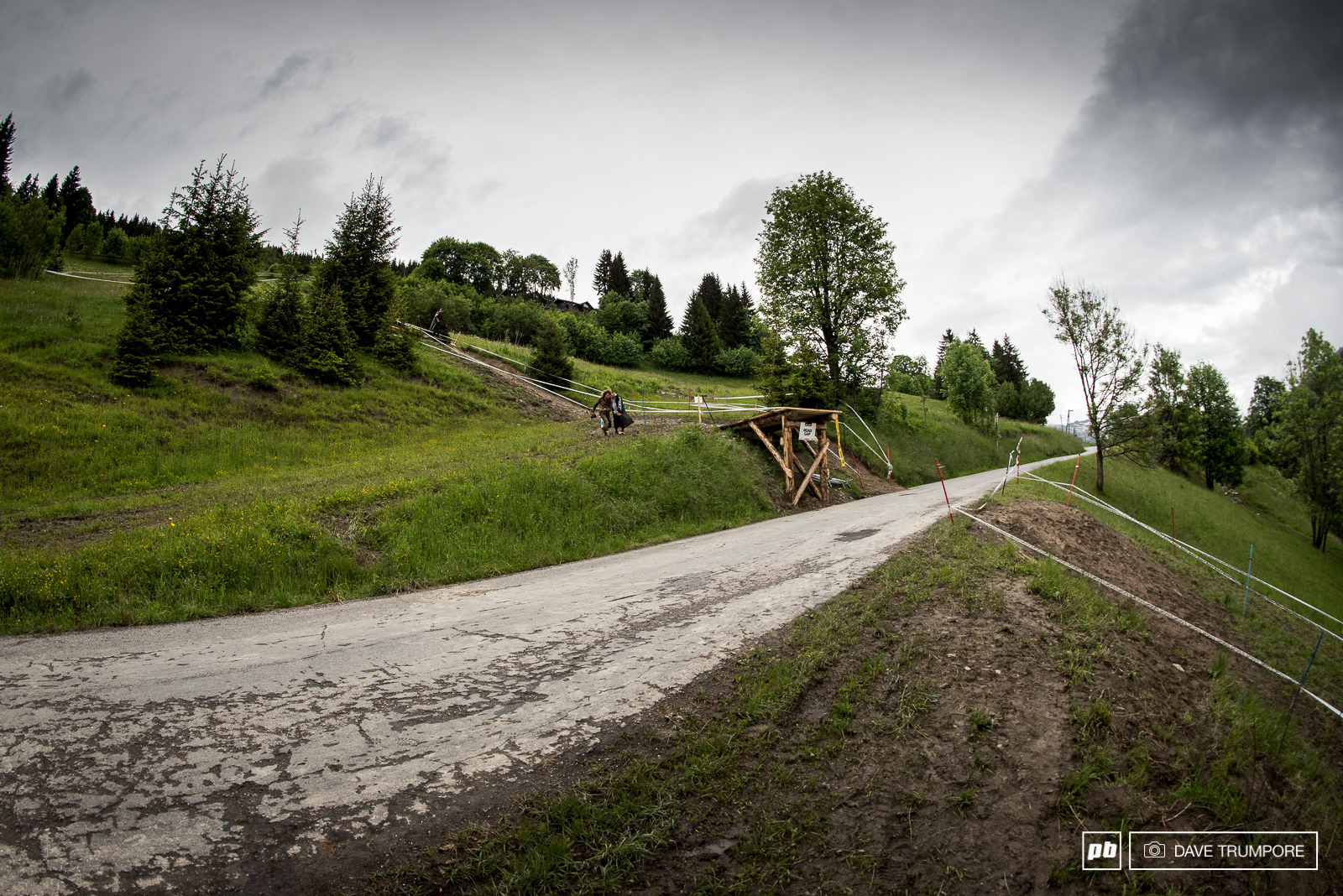 Slick and muddy corners lead to the final road gap on track where riders will have finally have the finish line in sight.