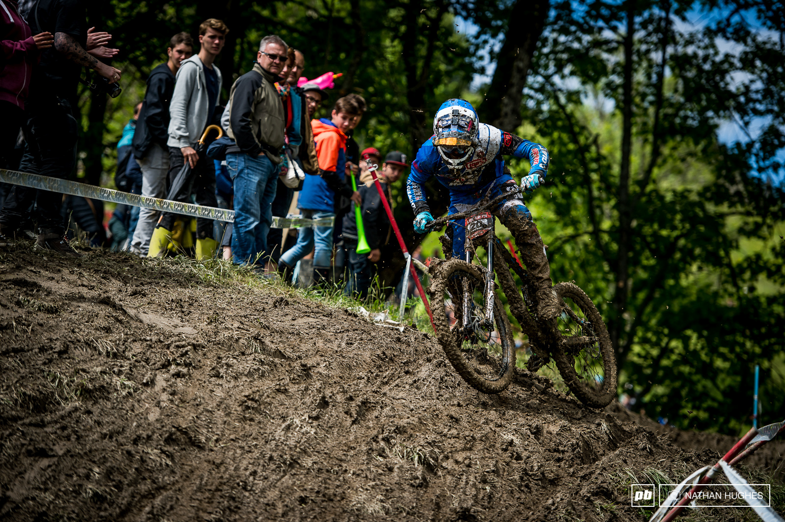 Alex Marin hovering above the slop with overloaded tyre treads.