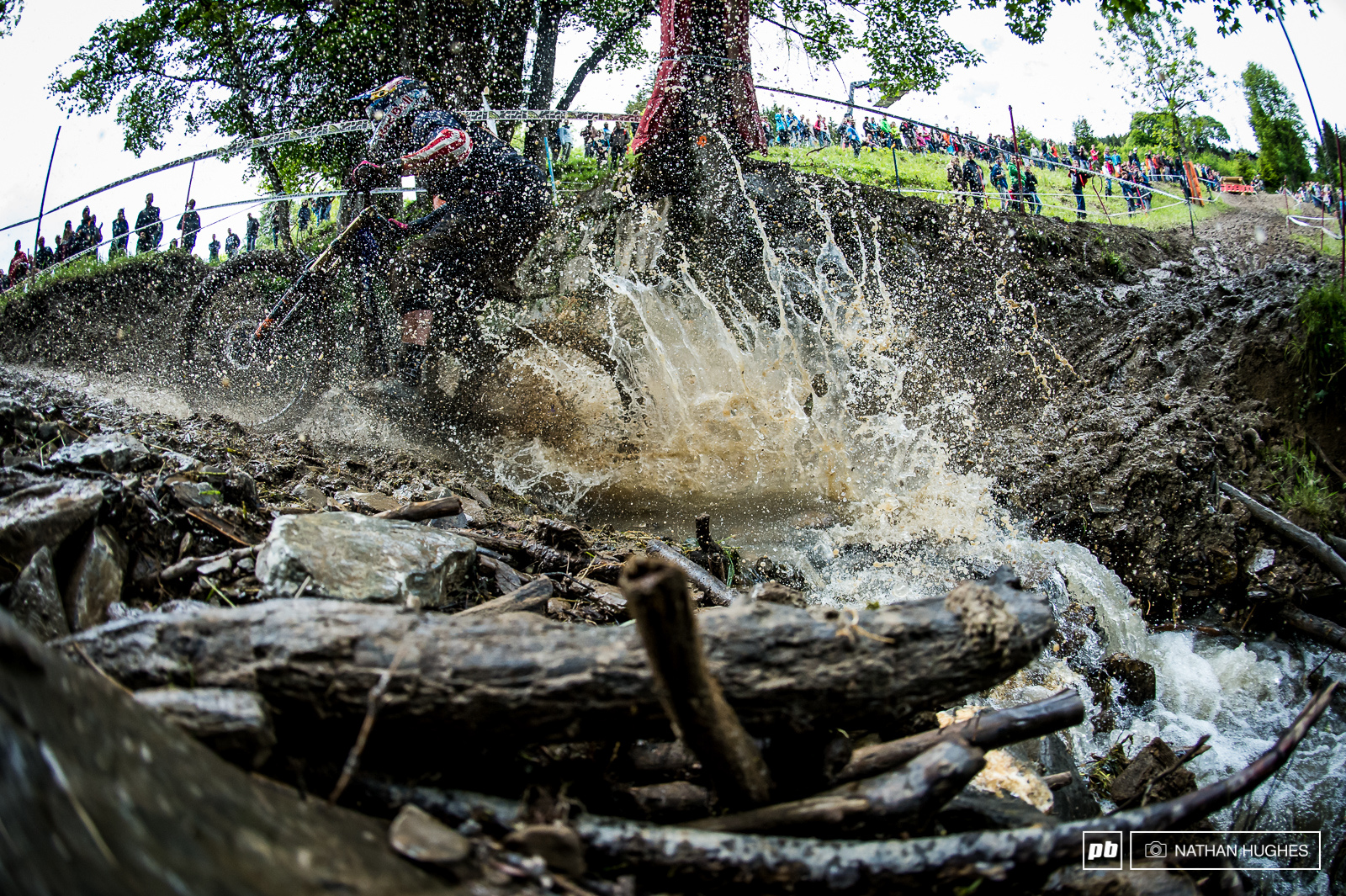 Jill Kinter smashing through the stream on the way to 5th and the mission to bring home the Queen of Crankworx grand prize.