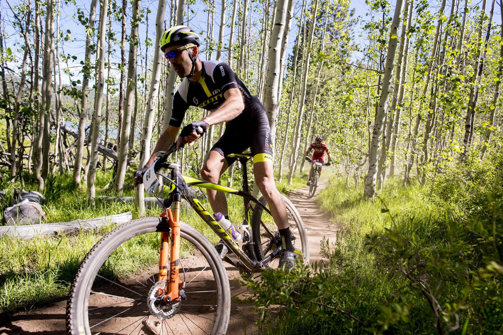 Geoff Kabush rails a turn under the shade of the Birch trees. Photo Brian Leddy