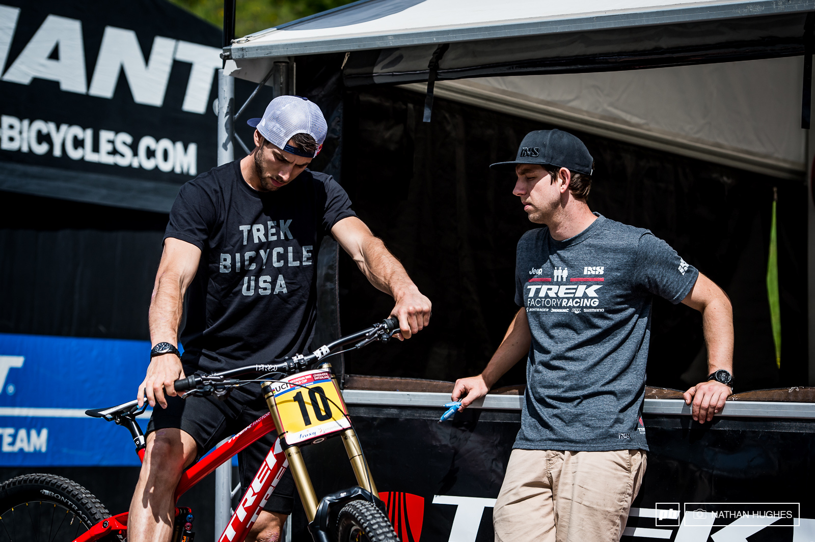 Gee Atherton getting the set-up right with mechanic Polish Pete.