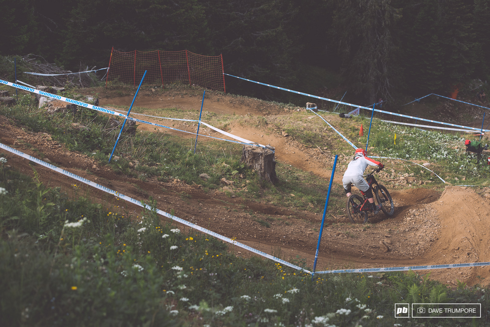 Jack Moir drops into the steep and loose switchbacks.