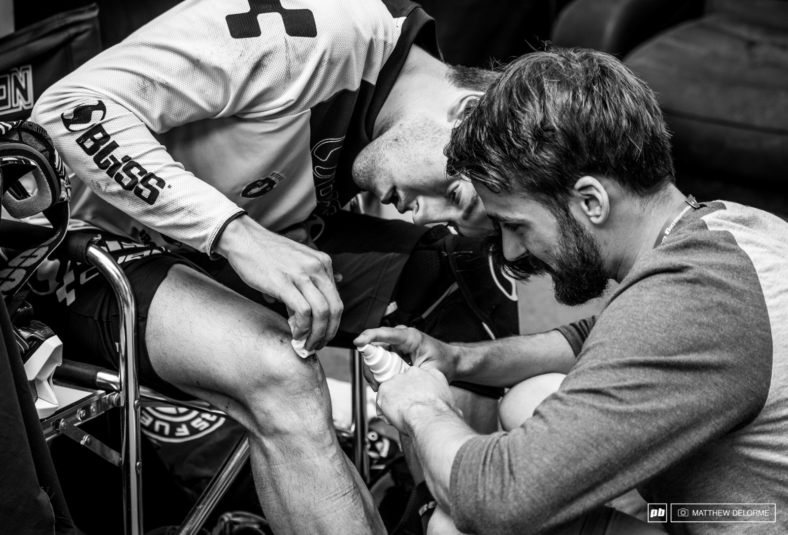 Greg Williamson tending to stitches from a crash on Friday practice.