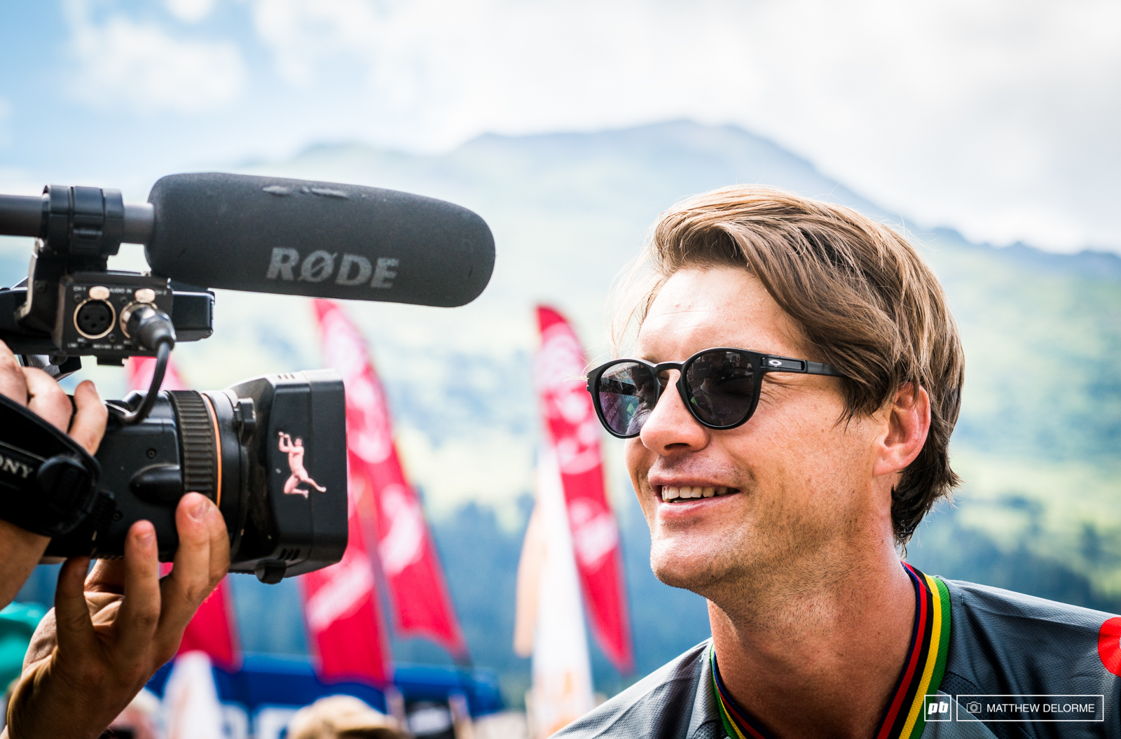 Is Greg smiling because he s notice the lens hood on this camera or because he s stoked on another trip to the podium.