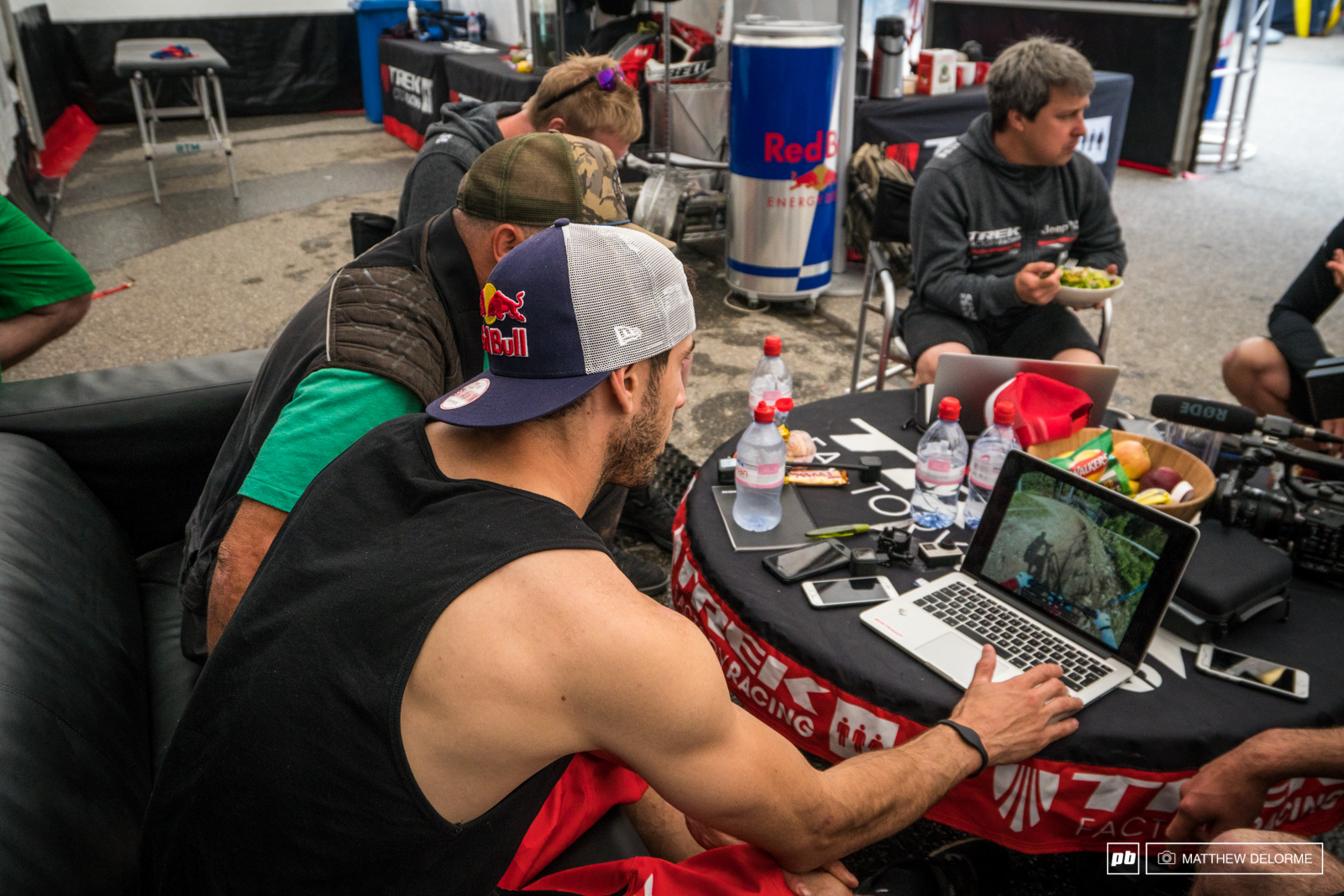 Gee going over GoPro footage before his race run to figure out where he can save some time.