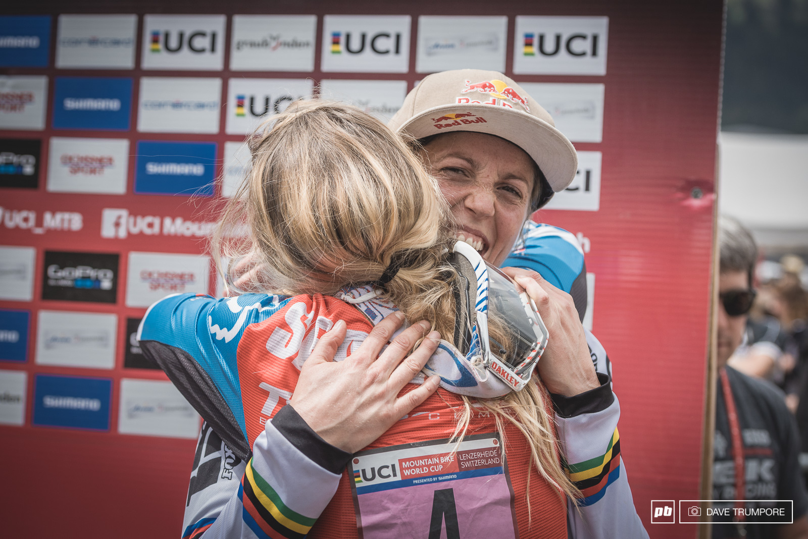 The current champion gives the next generation a hug after the pair went one-two here in lenzerheide.
