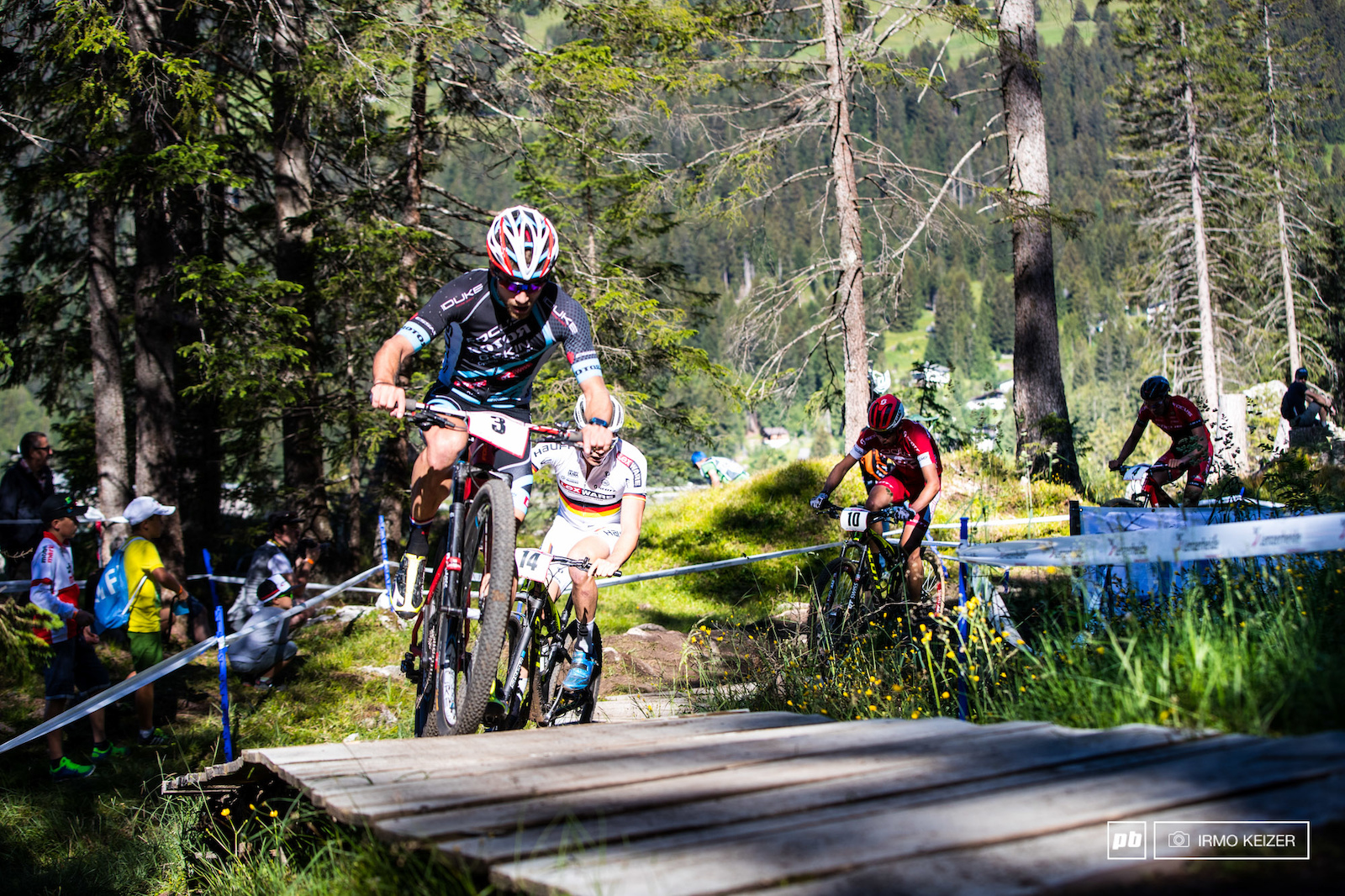 Romain Seigle Georg Egger and Andri Frischknecht in pursuit of the race leaders.