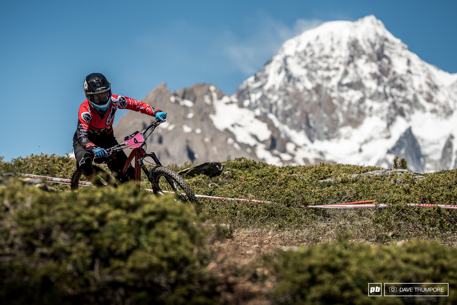Issabeau Cordurier drops into the top of Stage 2 with the imposing presence of Monte Bianco in the background. She is currently in second place and quite a far way off the pace of Cecile.