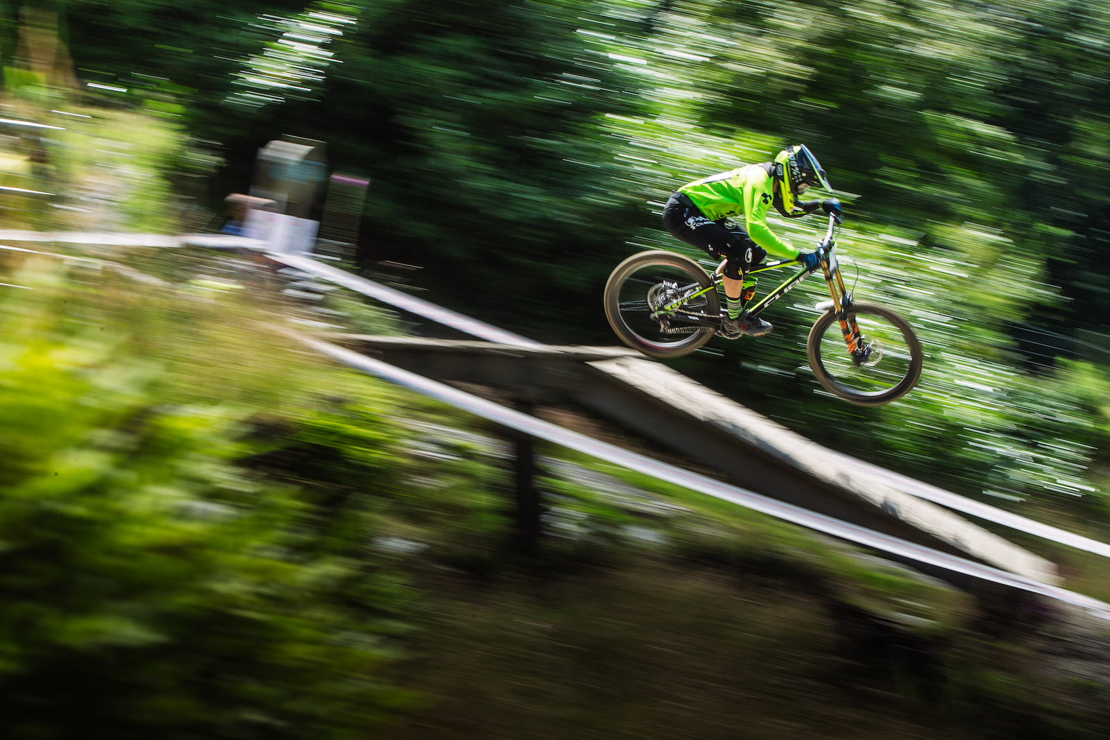 The man of the moment Greg Williamson dropping out of the woods into the fast open bottom section of track.