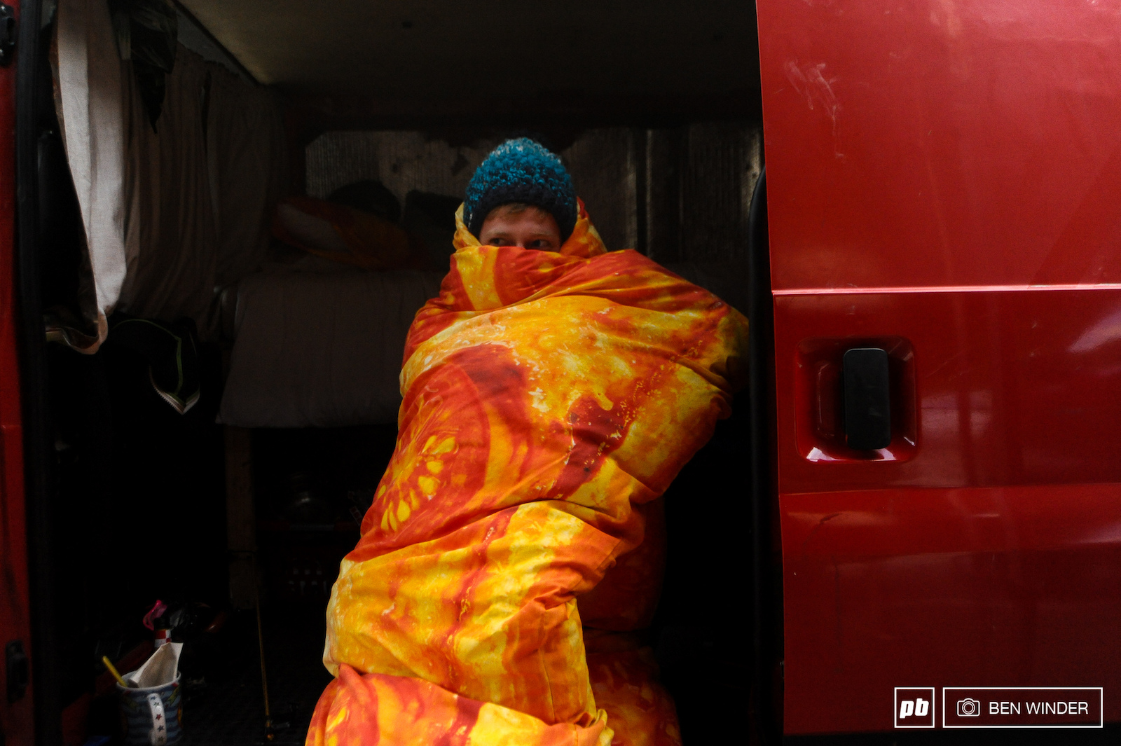 Tom Gaffney Norco Factory Racing Videographer living the high life wrapped up in a pizza.