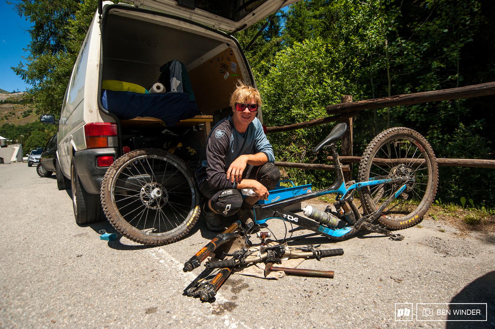 Gerd Skant living in his van and working on his bike.