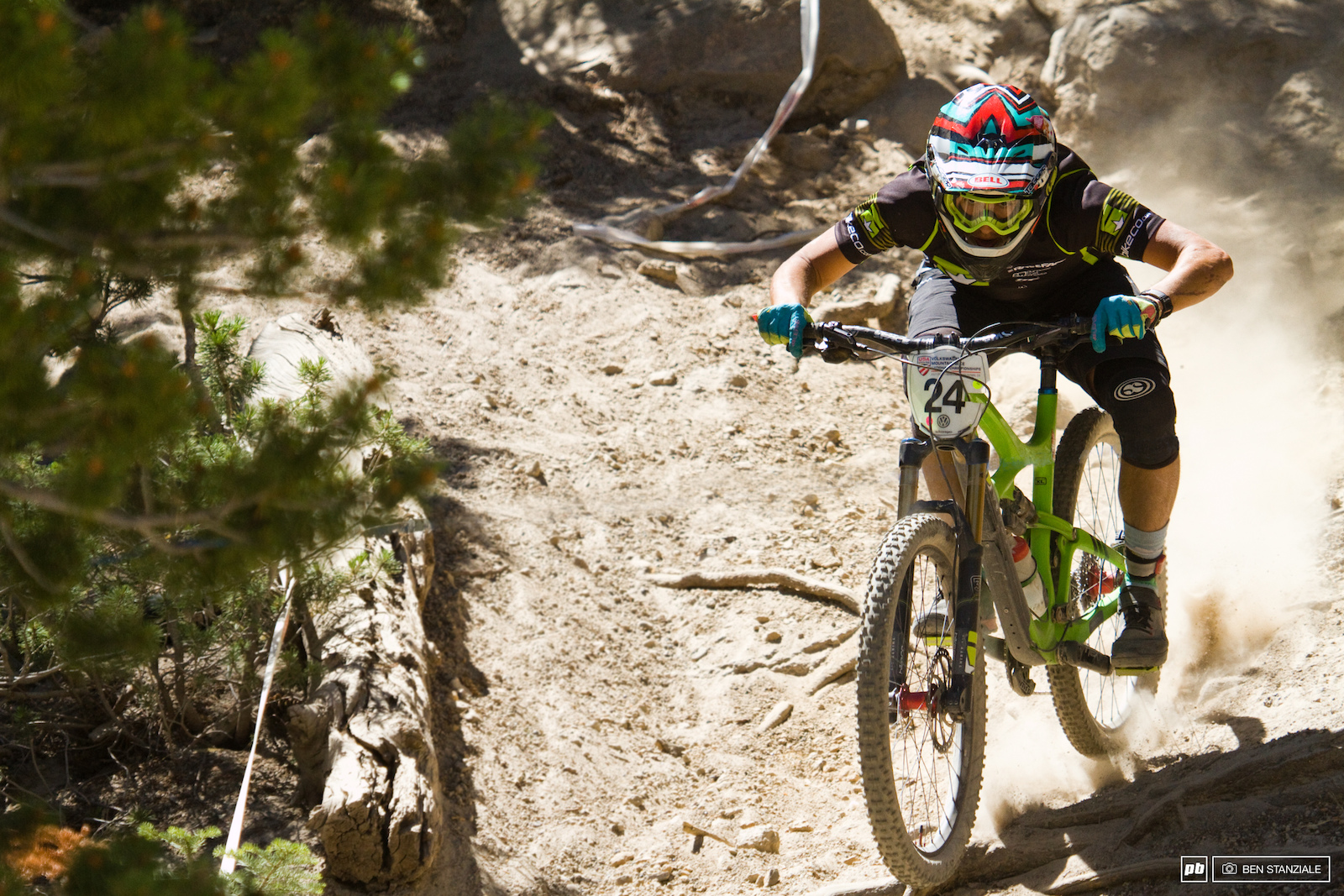 Pro Men riders make their way through a final rough and loose section before entering the slalom section of Stage 3.