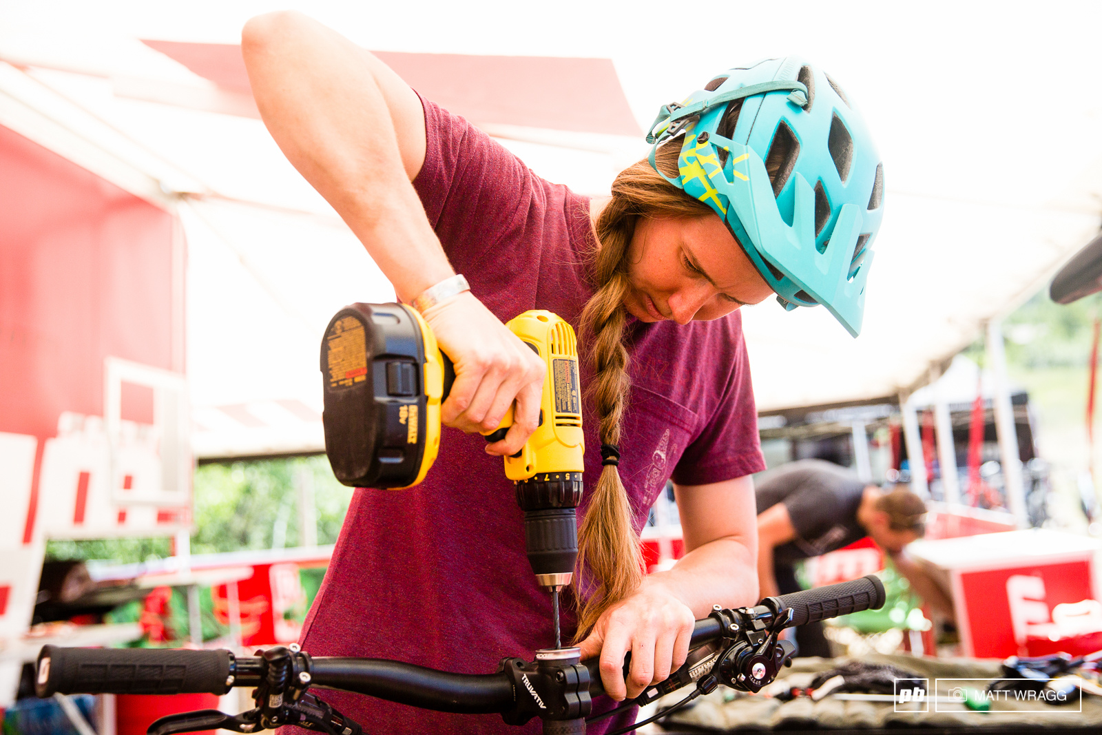 Miranda Miller is more than happy to get stuck in with her bike setup.