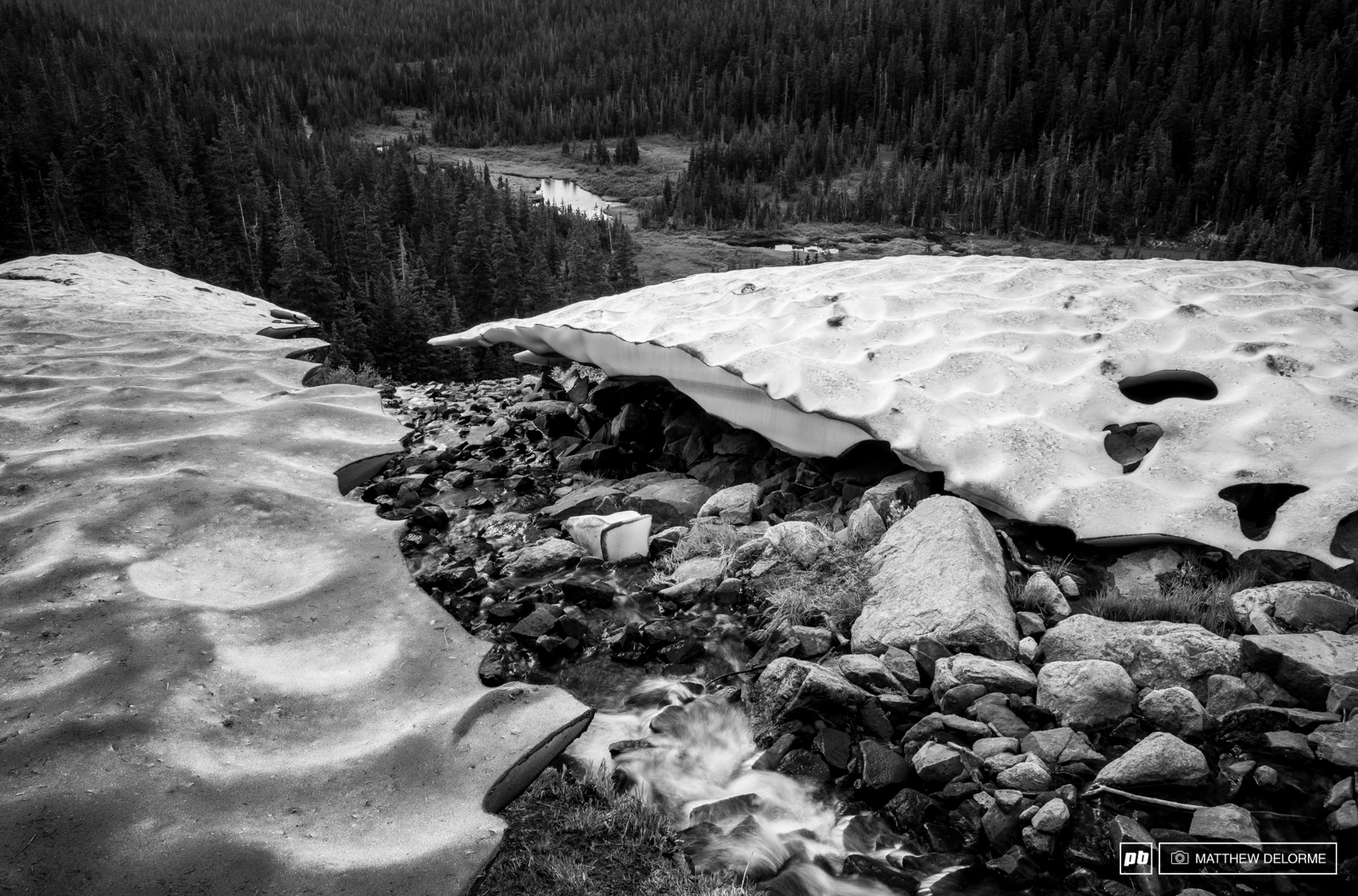 Glacial streams run off the higher summits to feed the alpine lakes below.