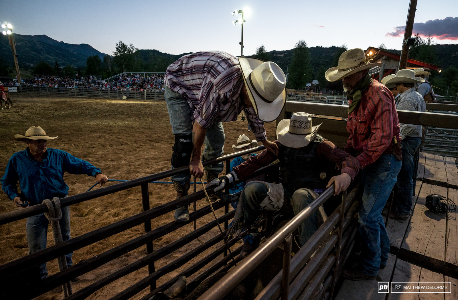 Loading into the cage and onto the bull this bull rider will try and stay on for eight seconds.