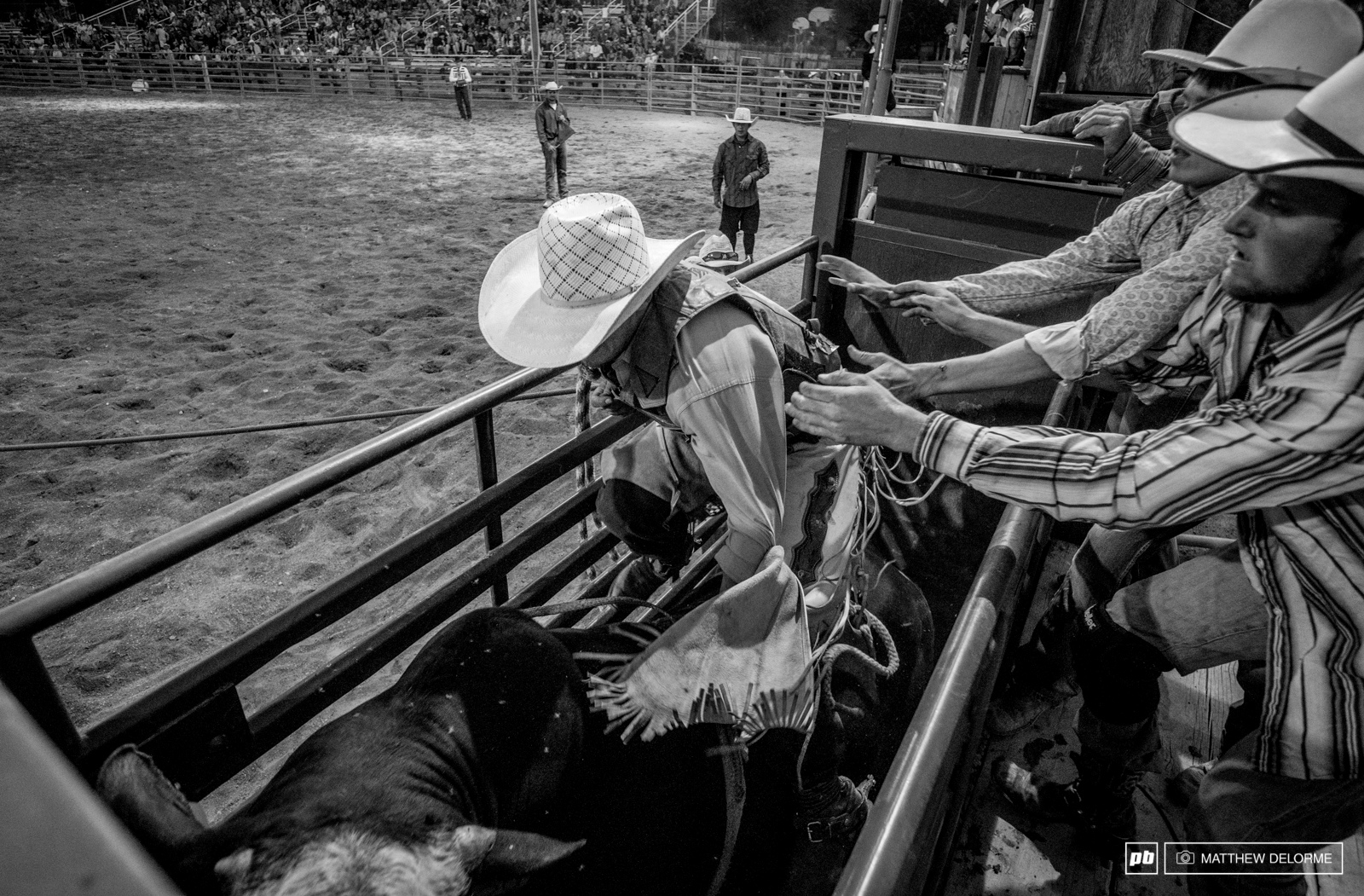 Loading onto the back of a pissed off bull is no easy task.
