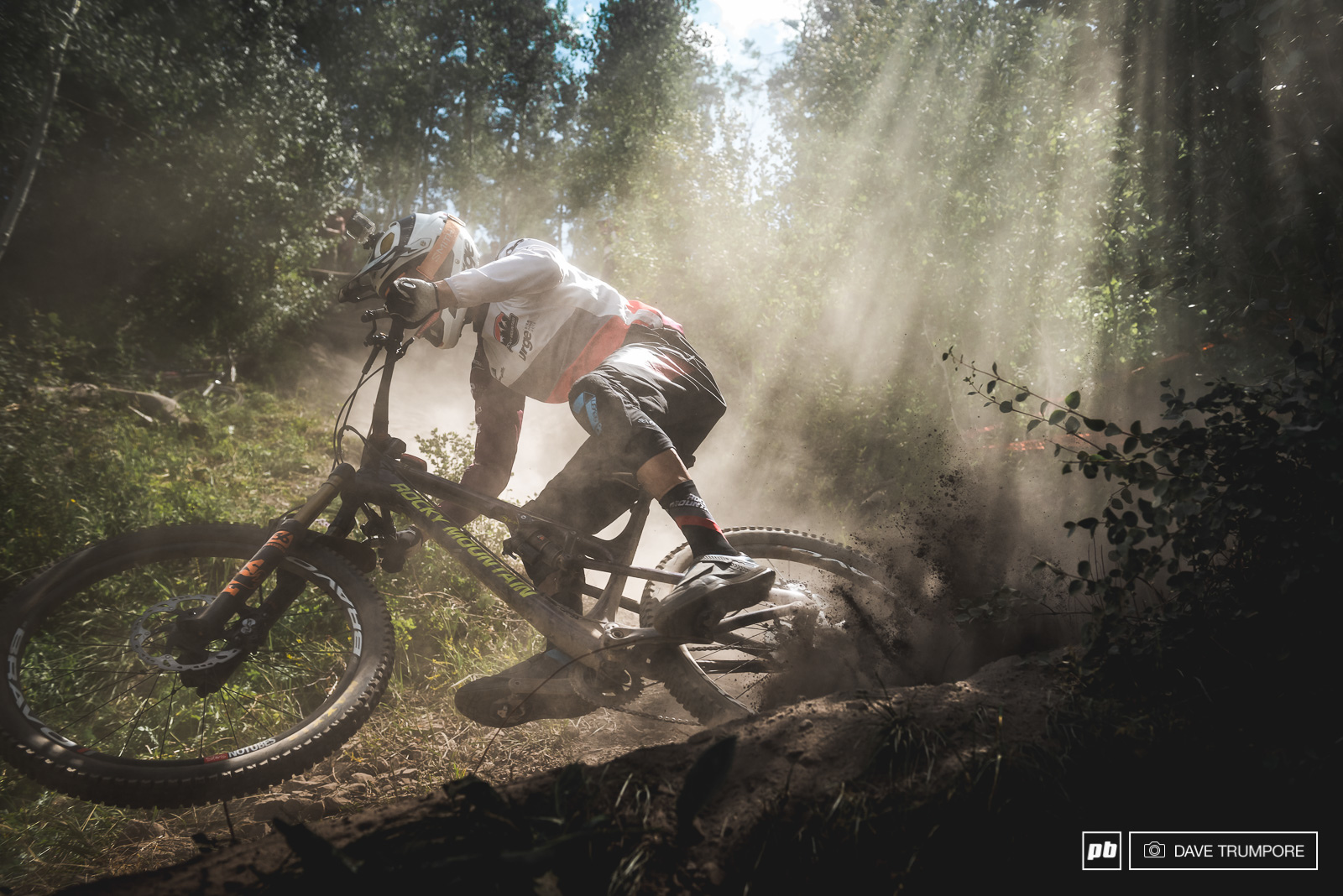 Florian Nicolai powers through the dust and epic light at the bottom of stage 6.