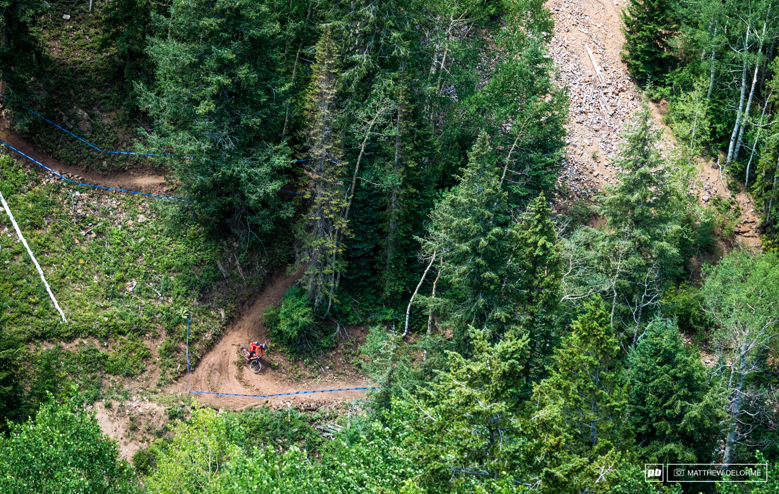 Loose Dog takes the inside line on one of the many blown out switchbacks on stage three.