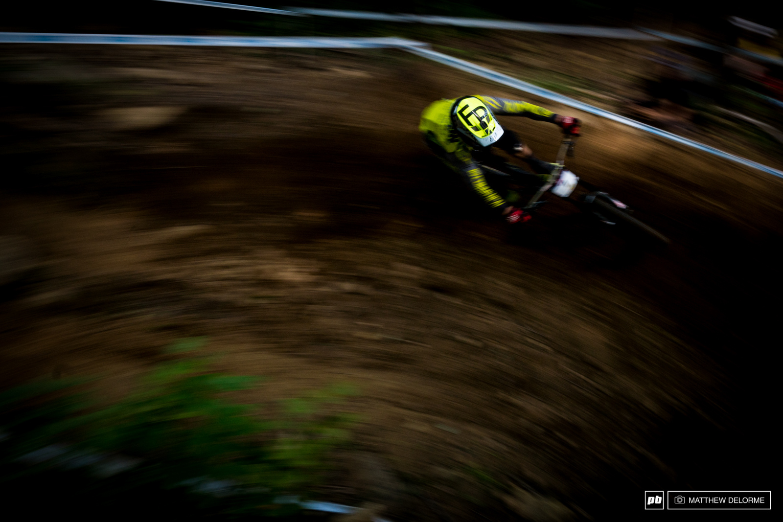 Remi Thirion slashing his way through the berms in the upper woods.