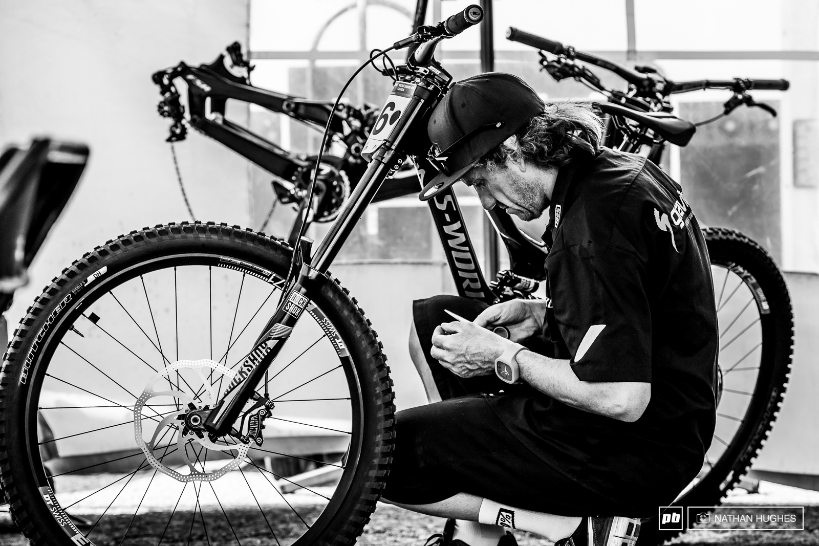 Jack makes the finishing touches to Loic s red hot ride in the Gravity Republic pit.