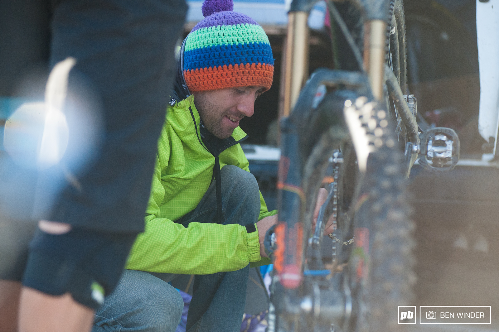 Baptiste Gaillot make a few changes to his bike first thing in the morning.