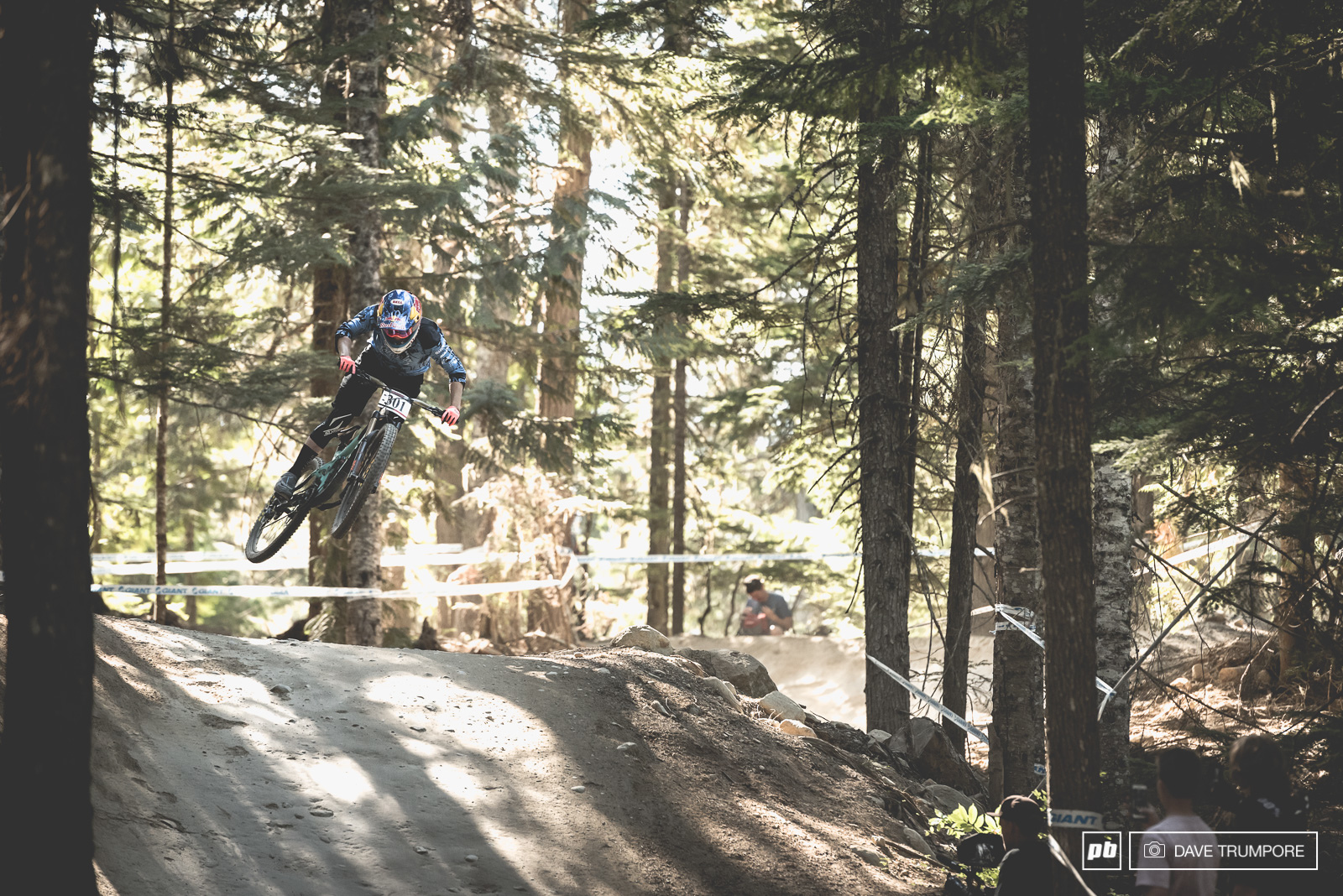 Jill Kintner keeps it low through the lower jumps on her trail bike.