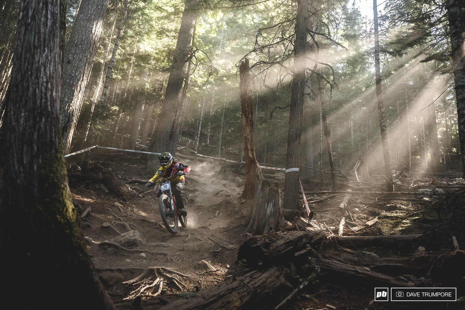 Alexandre Fayolle sends it straight down the main line. Nothing fancy and way to fast to even notice the epic light firing through the lower woods.