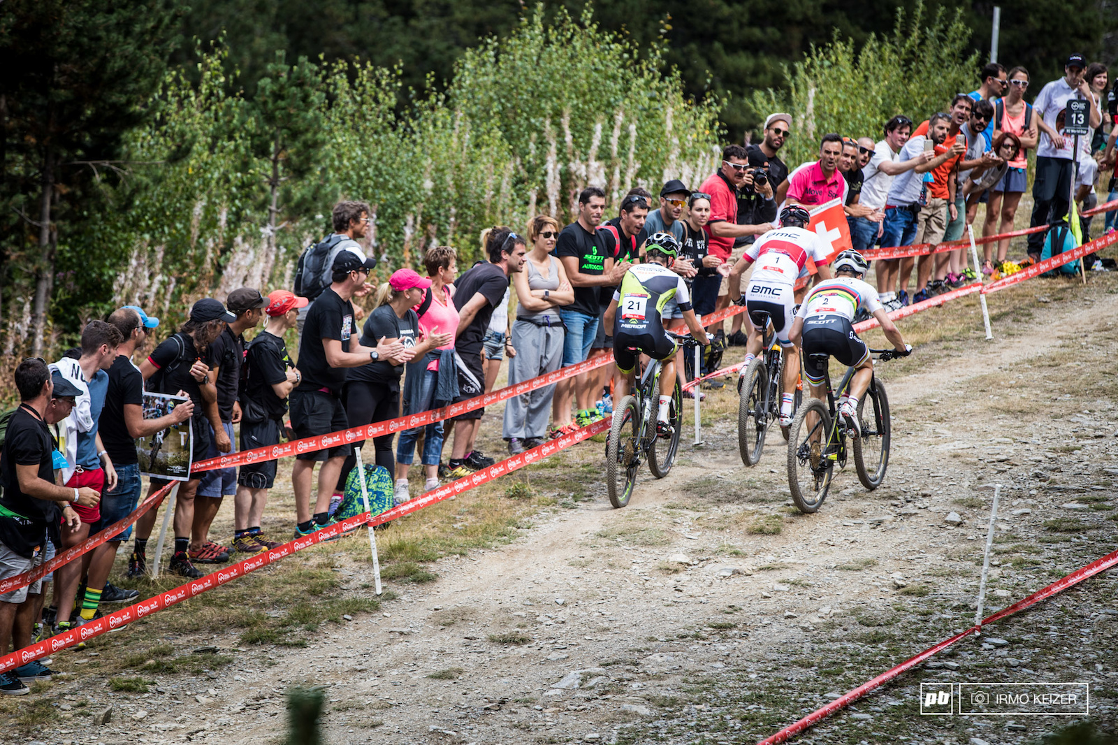Ondrej Cink gets caught by Julien Absalon and Nino Schurter. Absalon would power away moments after.