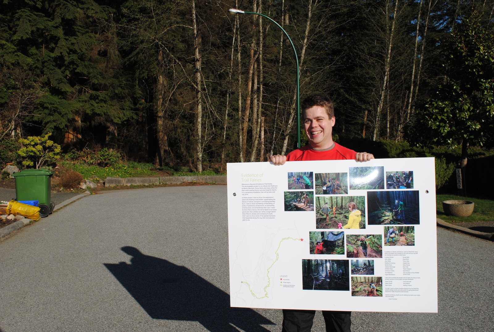 Excited to see the info posters for the first time It took 6 trips to hike everything in. Until we were ready to put it all up I kept everything hidden off the trail in black garbage bags to make it harder to spot and to protect it from the elements. Photo by Kathryn Toews.
