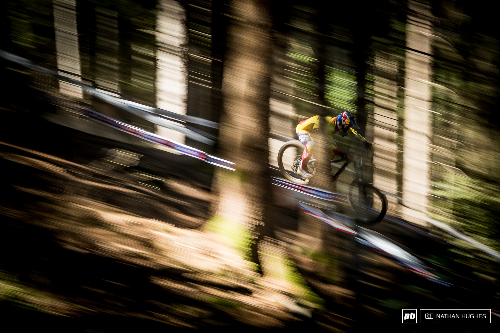 Marcelo Gutierez powering though the trees for team Colombia.