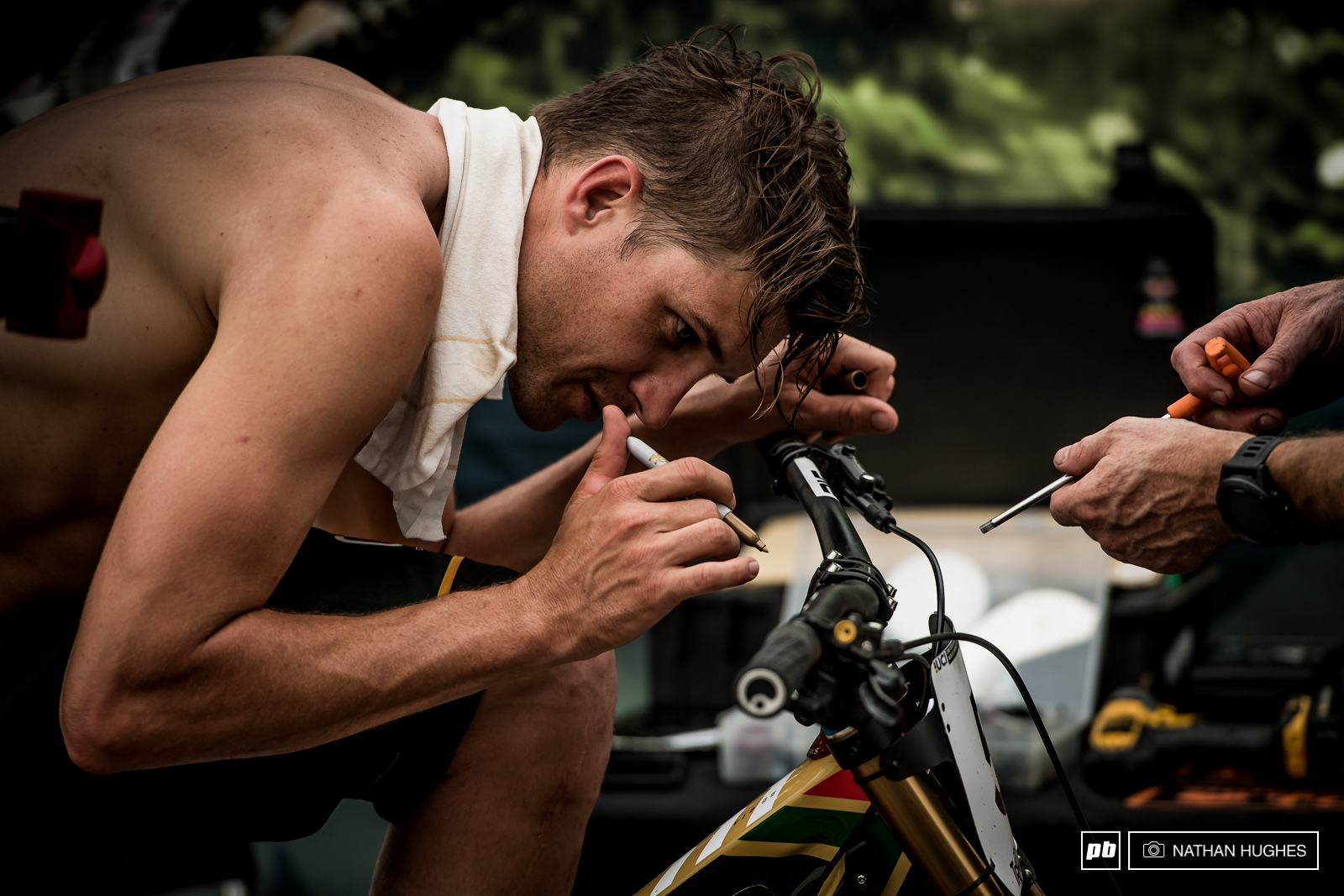 The devil is in the details... Minnaar does hard time in the pits after seeding with his mechanic to get things perfect... More perfect.