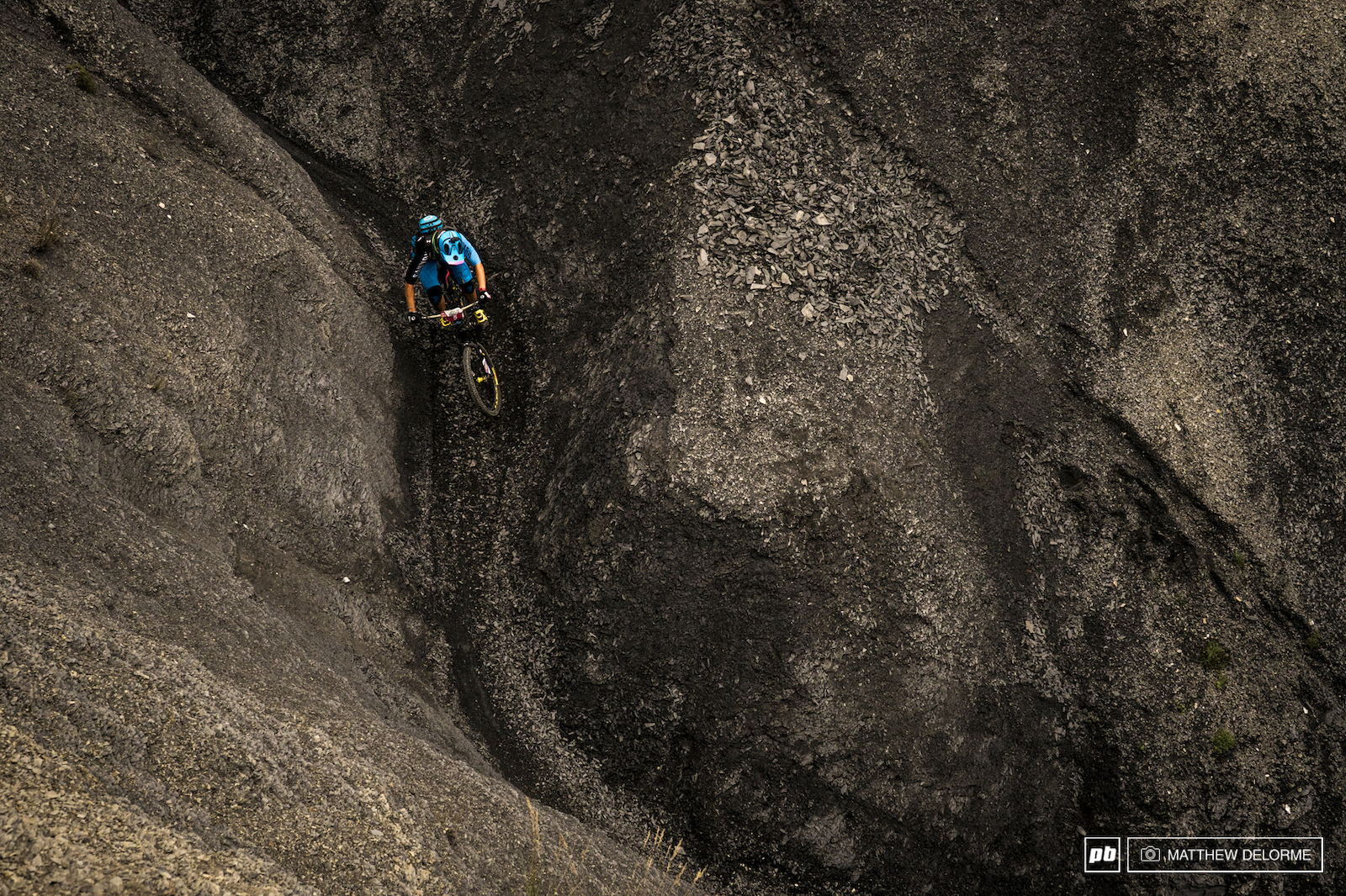 Grey Earth. Looks like an old Match Stick Productions freeride spot for trail bikes.