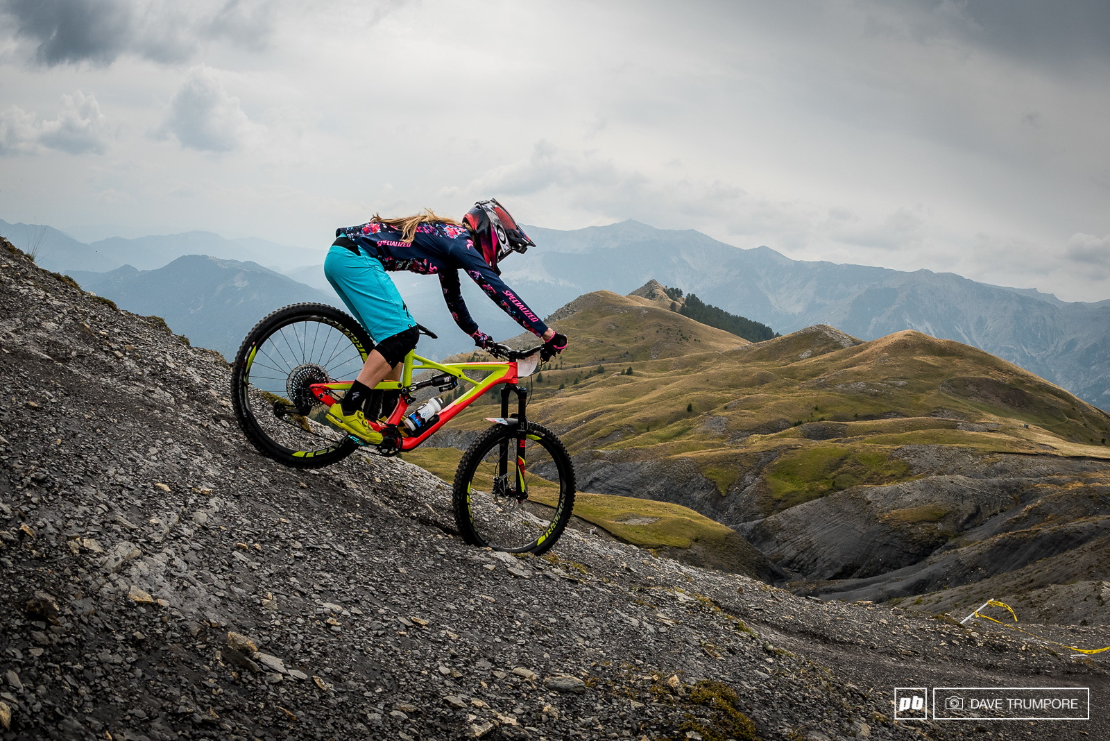 Hannah barnes drops in while the picturesque Martime Alps loom in the background.