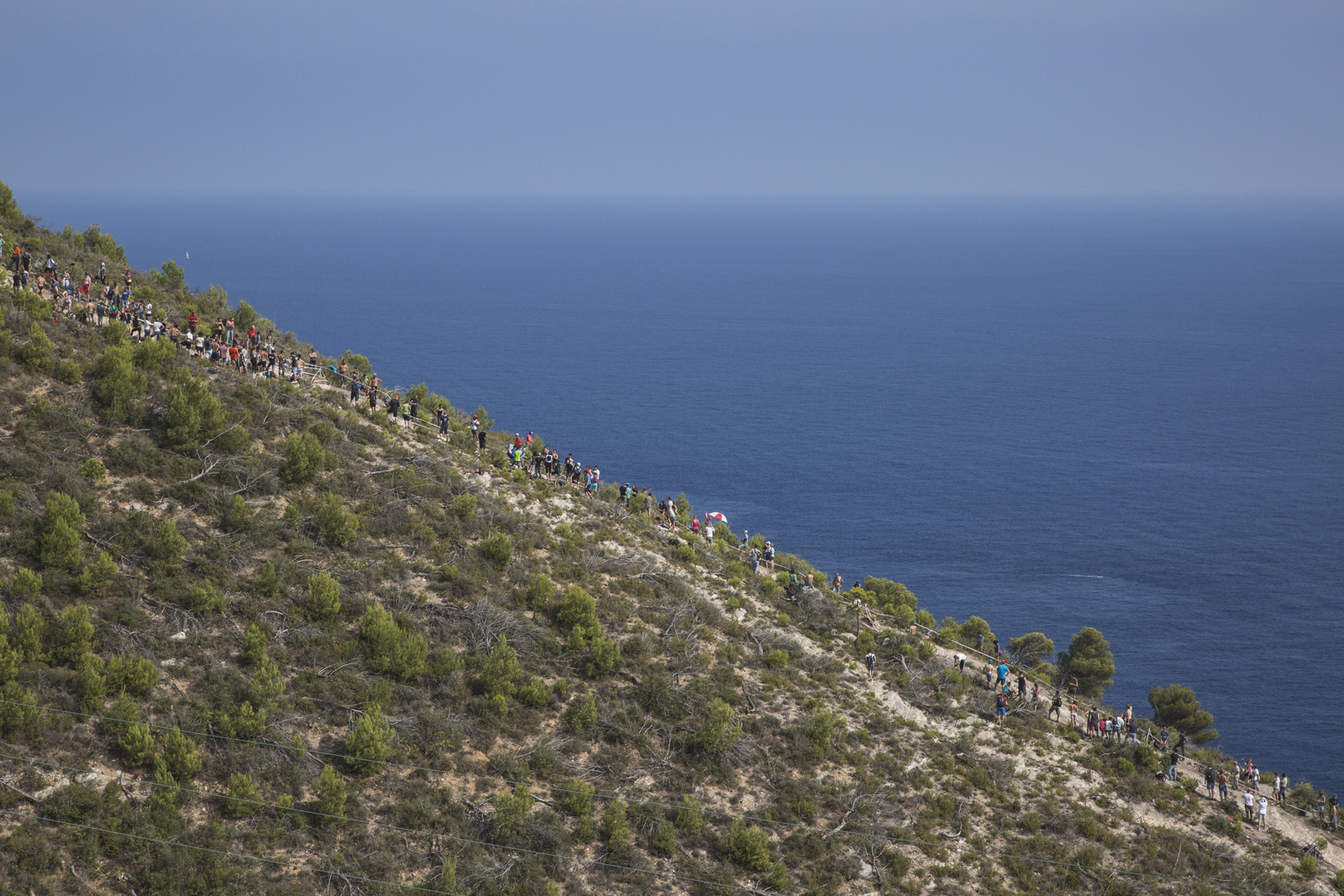 The fans lined the hillside above Varigotti to cheer the riders on down stage 7. Photo - Brady Lawrence.