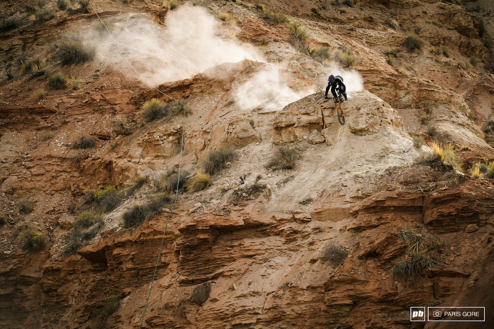 Tom Van Steenbergen testing out a drop mid mountain.