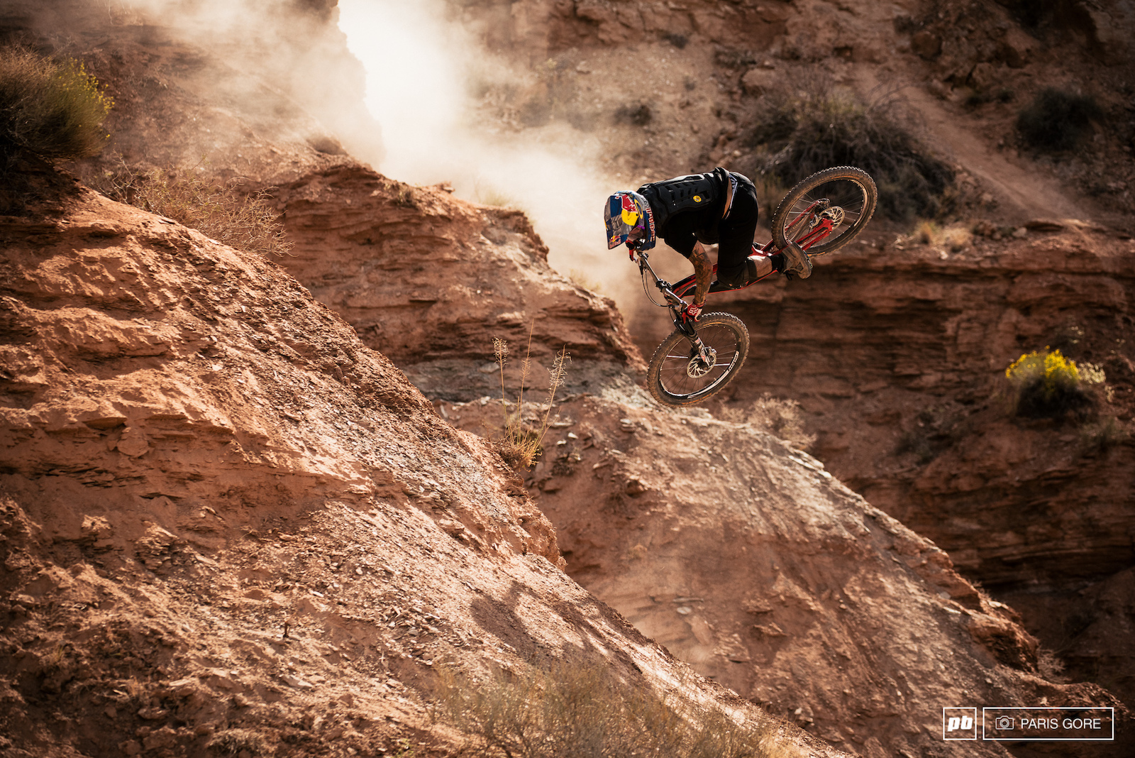 Andreu Lacondeguy spinning halfway down the mountain and into a heavy drop.