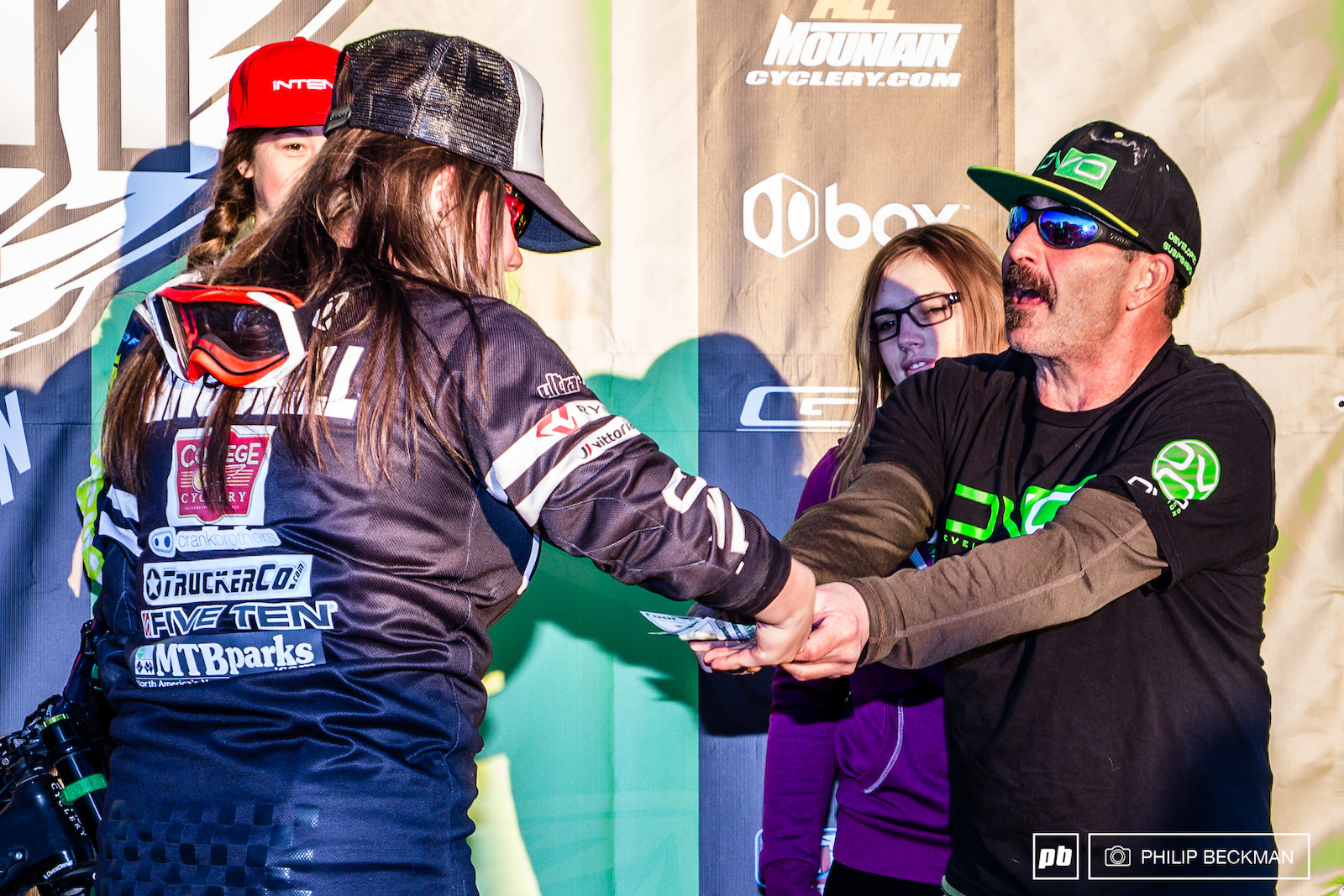 A generous purse was on offer equally split between the Pro Men and Women. Here event promoter Downhill Mike Sheur hands Samantha Kingshill a cool 500 in cash. This kind of payout indeed the event itself would not have been possible without the support of DVO Suspension Box Components Promax GT Bicycles All Mountain Cyclery Deity Novatec HT Components Smanie Onza KHS Bicycles Canfield Bros Truckerco Kali Protectives Kore North Bikes Gravity Cartel IXS Spank Flitelinez Lectric Bikes Haibike the Whiteface Mountain Bike Park ODI Grips and Pinkbike. While we re at it let s recognize the contributions of Dan Haskin the late Brent Thomson as well as the Boulder City Parks Department.