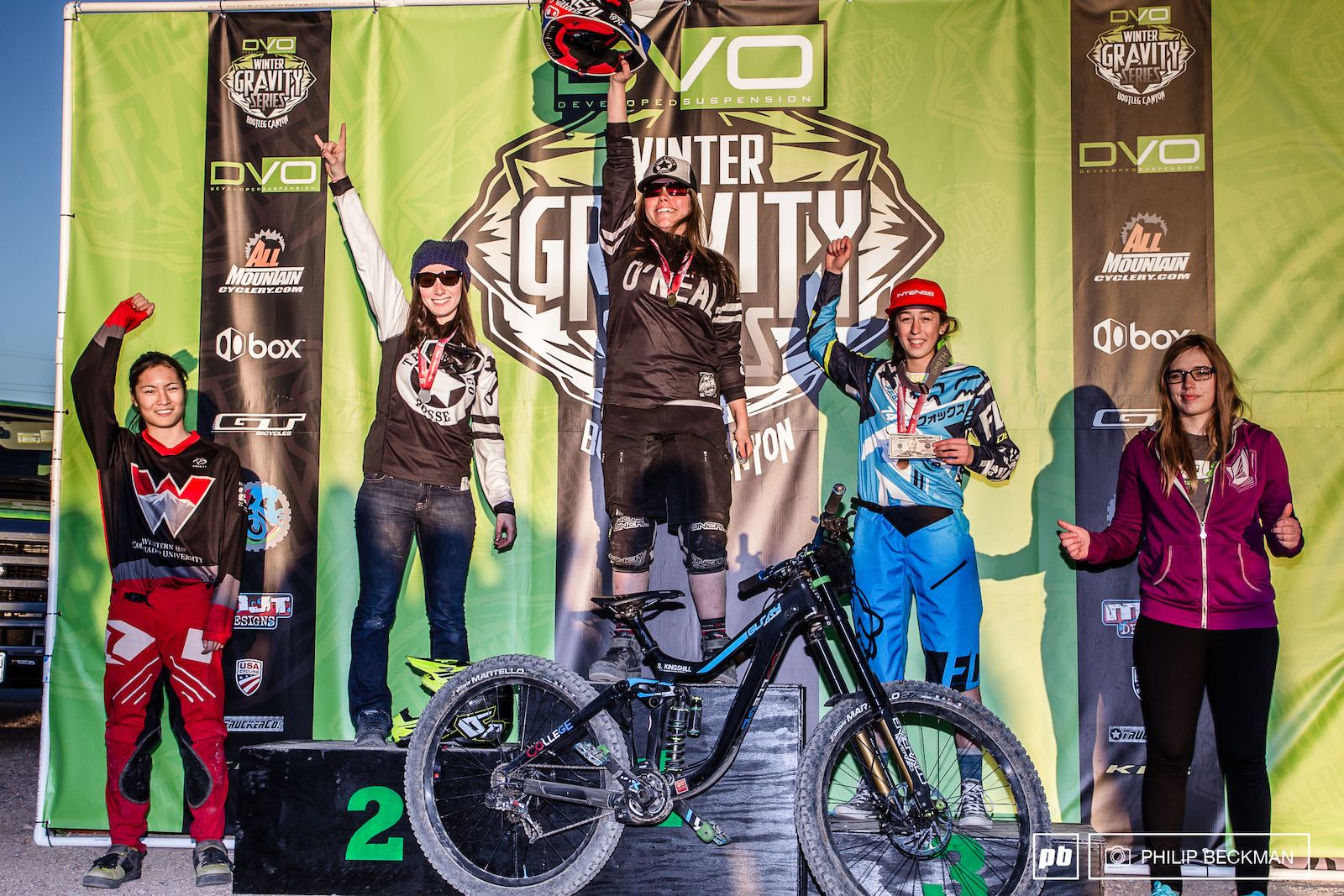 The Pro Women s podium featured reigning National Champ Samantha Kingshill College Cyclery O Neal Truckerco at the peak attended by CJ Selig Truckerco Five10 DVO Emily Gacad Incycle Intense Ming Goetz and Lecksi Winger Ellsworth .