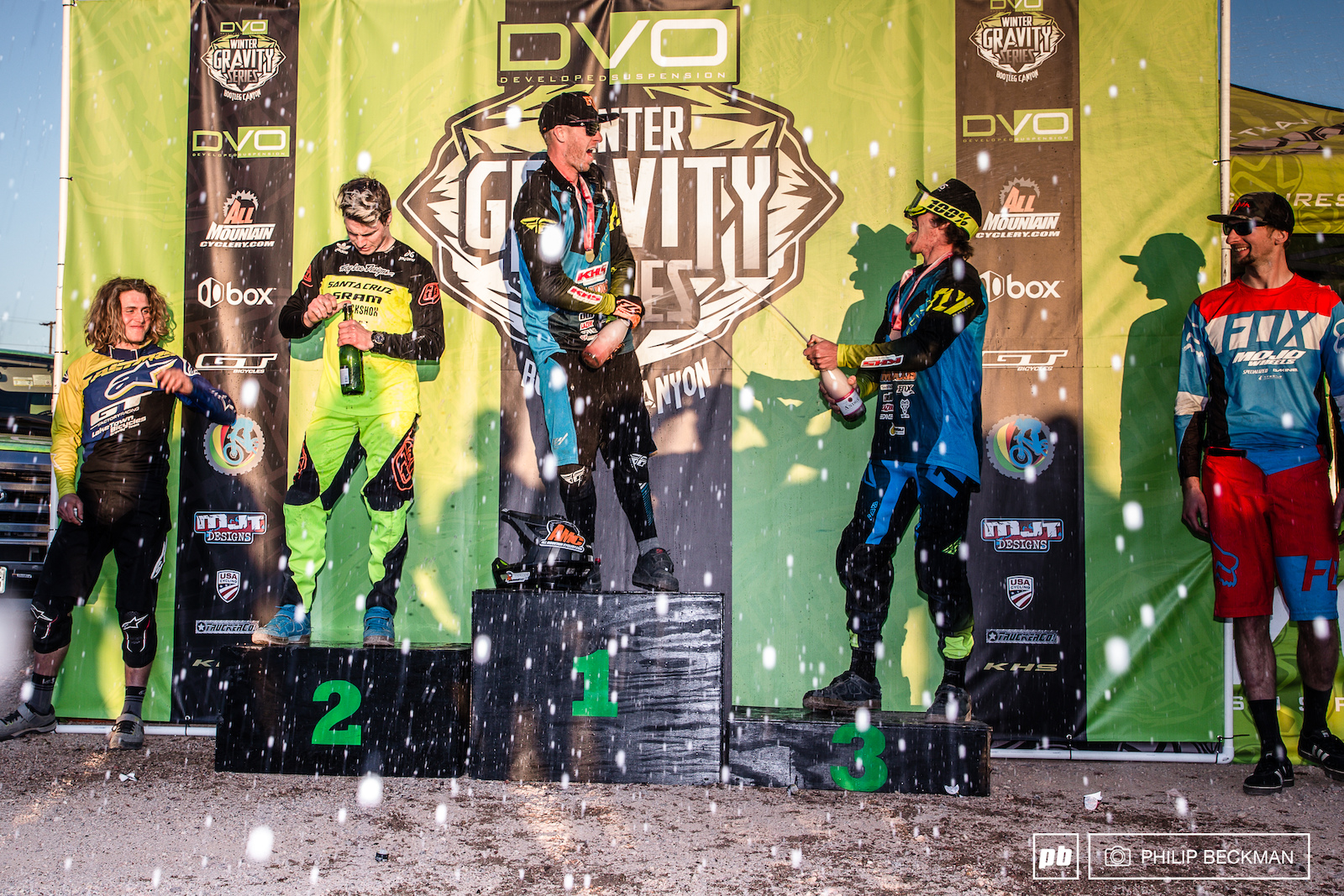 While Demetri Triantafillou LakeTown Bicycles and Chris Higgerson Mojo Wheels Foxhead look on KHS teammates Logan Binggeli and Bruce Klein engage in champagne battle. Second place finisher Mitch Ropelato Santa Cruz SRAM TLD was a little late to the party. Your Pro Men s DH podium.