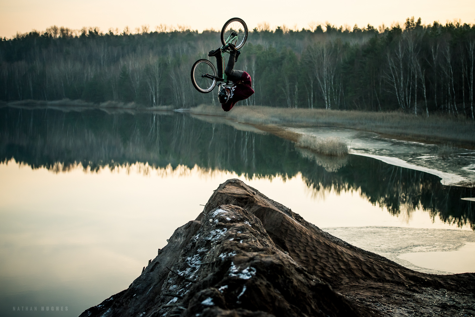 Front flipping the lake jump before the big freeze.