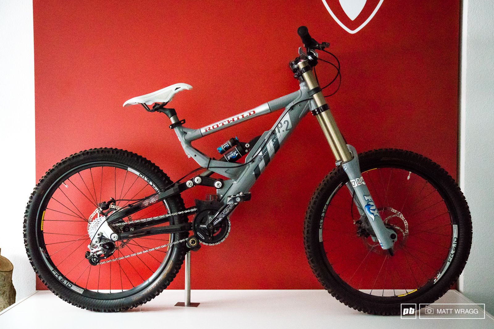 This was Rotwild s last World Cup DH bike from around 2007. It may not be as wild as their RDH1 prototype but this frame has adjustable geometry an air shock and even a carbon fibre rear end. While it may look dated now these kind of details prefigure the modern downhill bike.